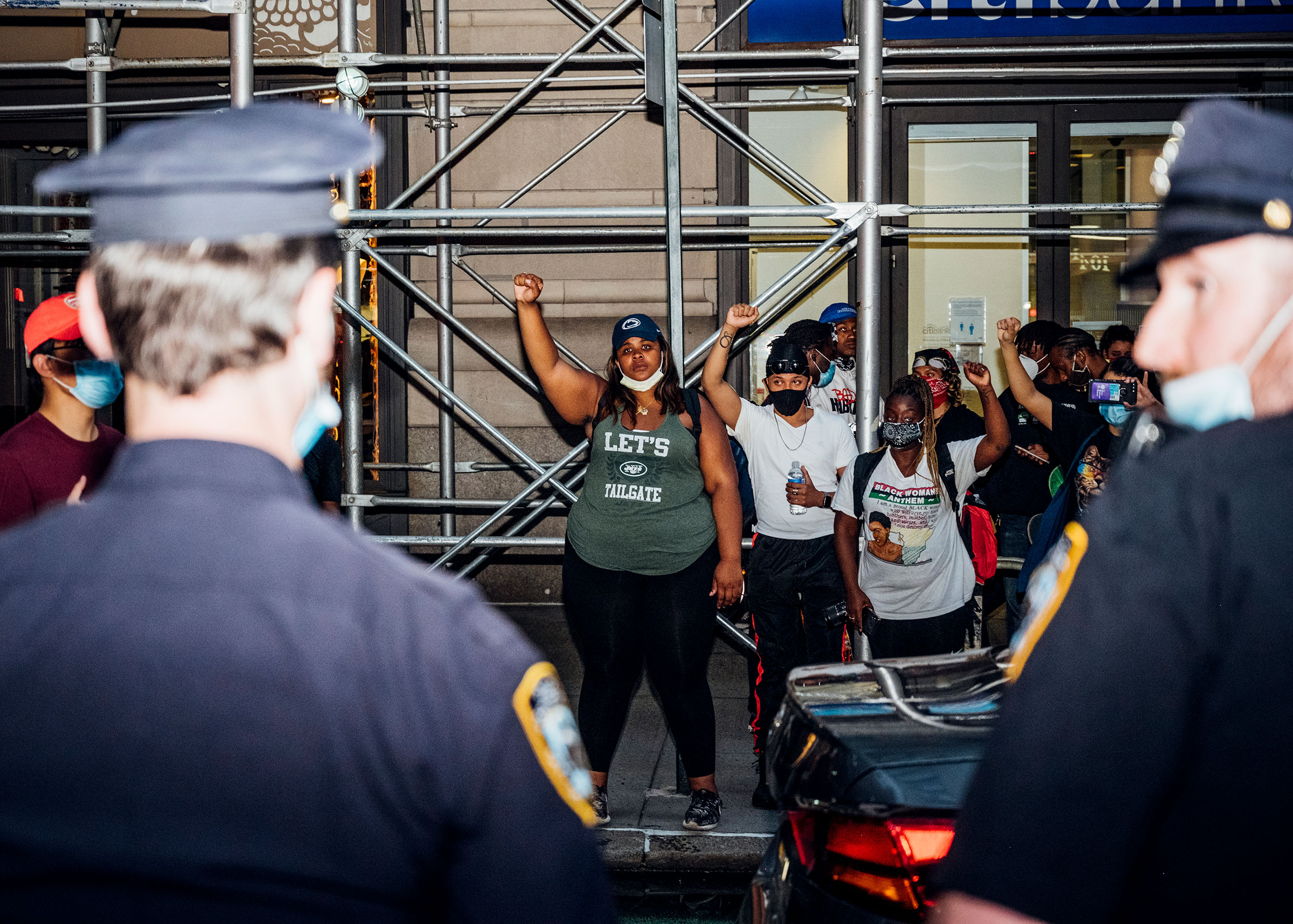 In the wake of George Floyd's death, protesters face off with police officers during another night of demonstrations in Manhattan on May 30, 2020.