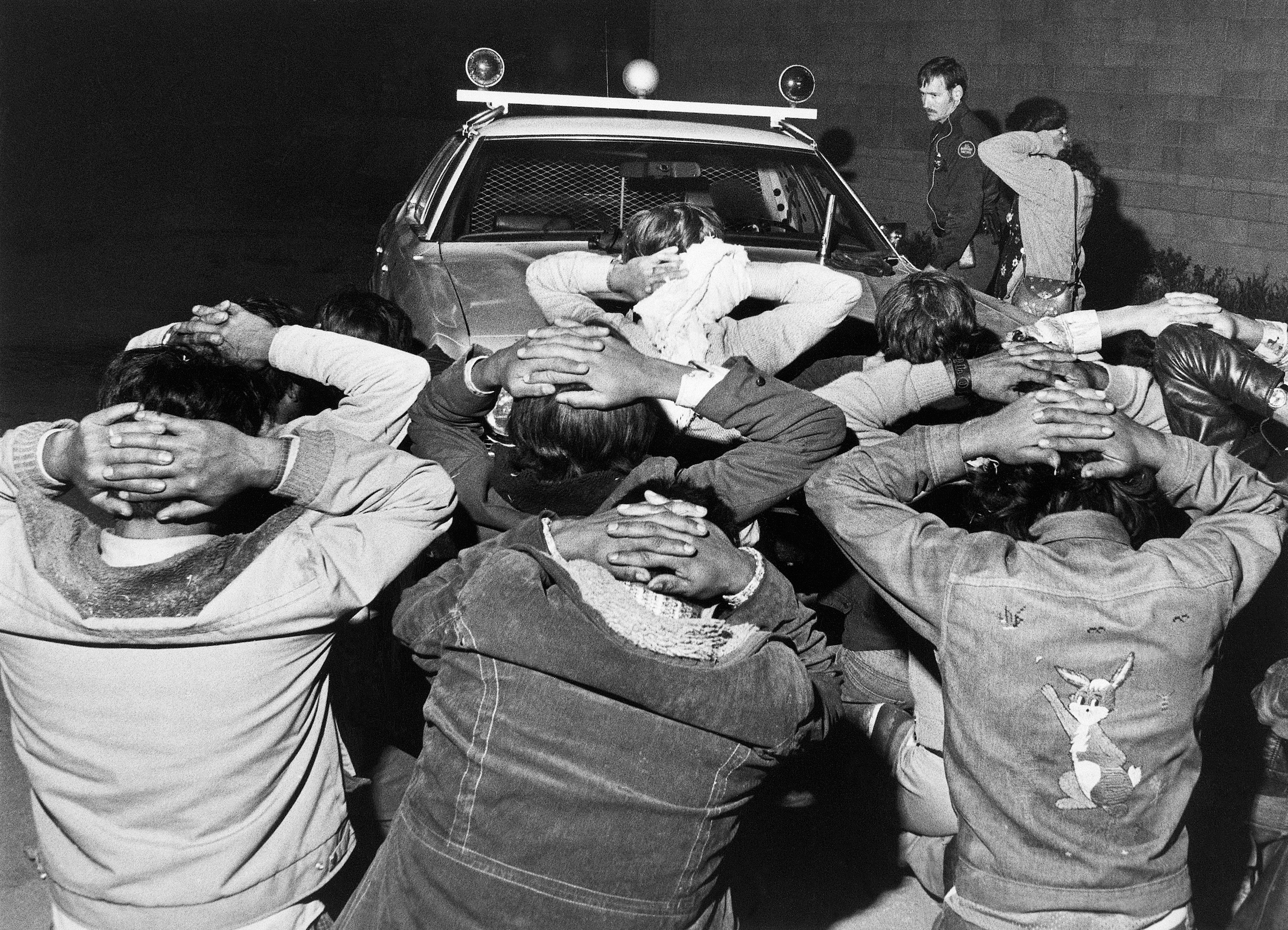 Men who have been caught trying to cross the border from Mexico to the United States, in Tijuana, Mexico, on May 11, 1977.