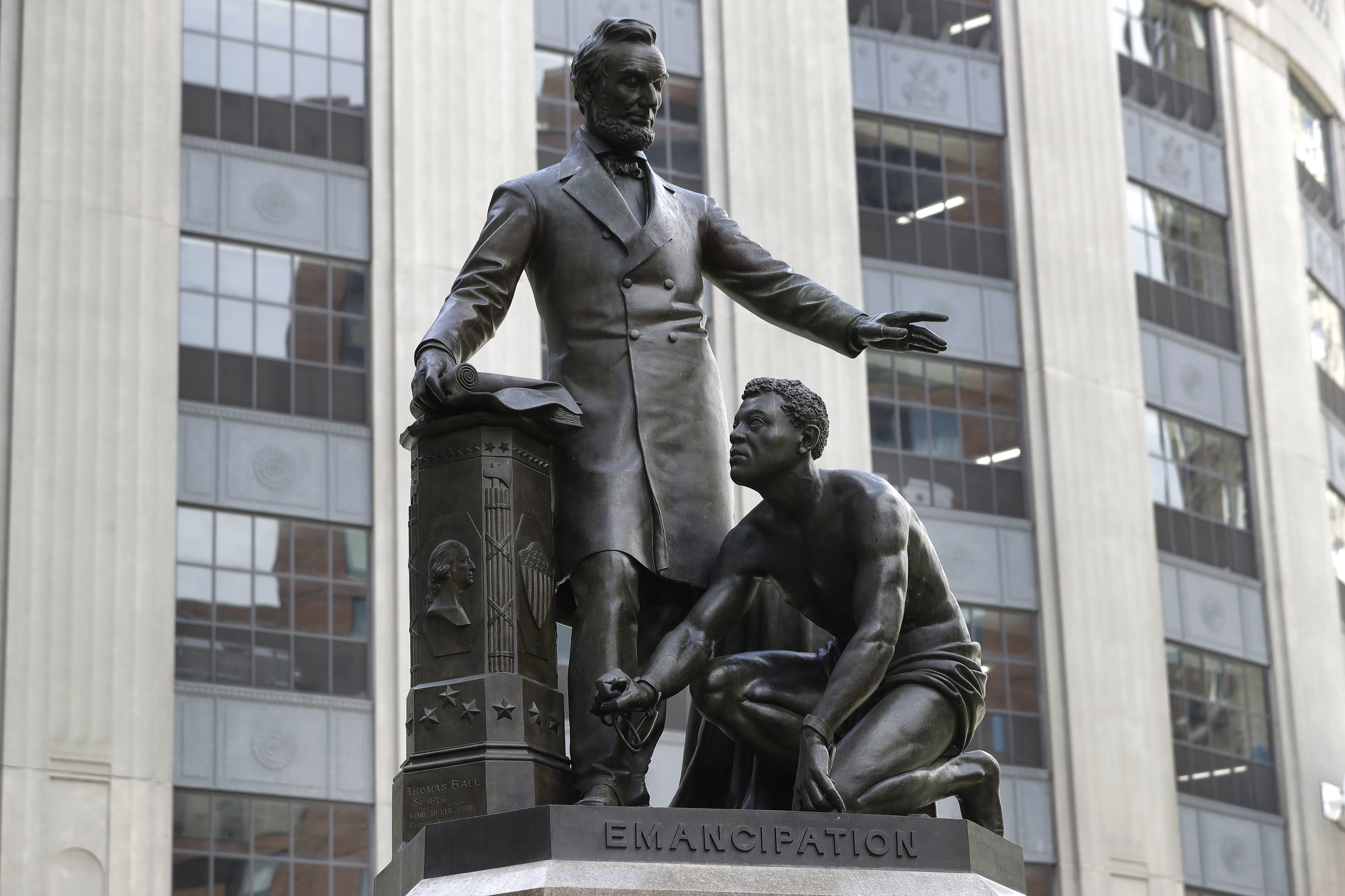 A statue that depicts a freed slave kneeling at Abraham Lincoln's feet rests on a pedestal in Boston on June 25, 2020.