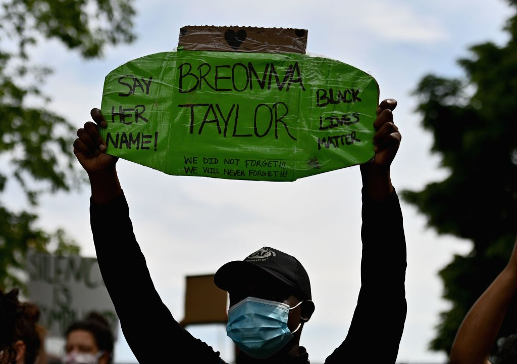 Protesters hold up signs on June 3, 2020, during a  Breonna Taylor and Black Lives Matter  protest in New York City.