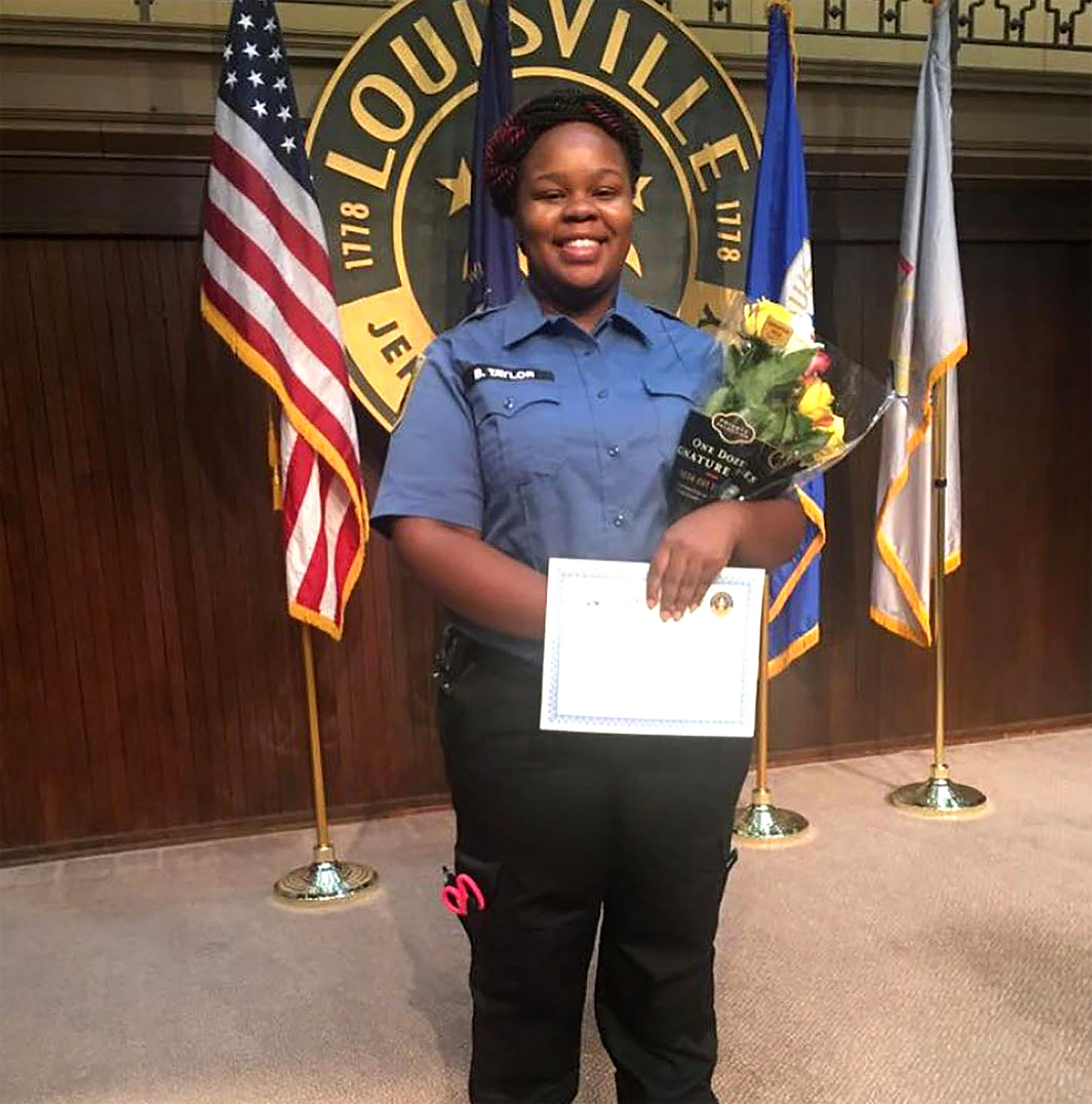 Breonna Taylor poses for a photo during a graduation ceremony in Louisville Kentucky.