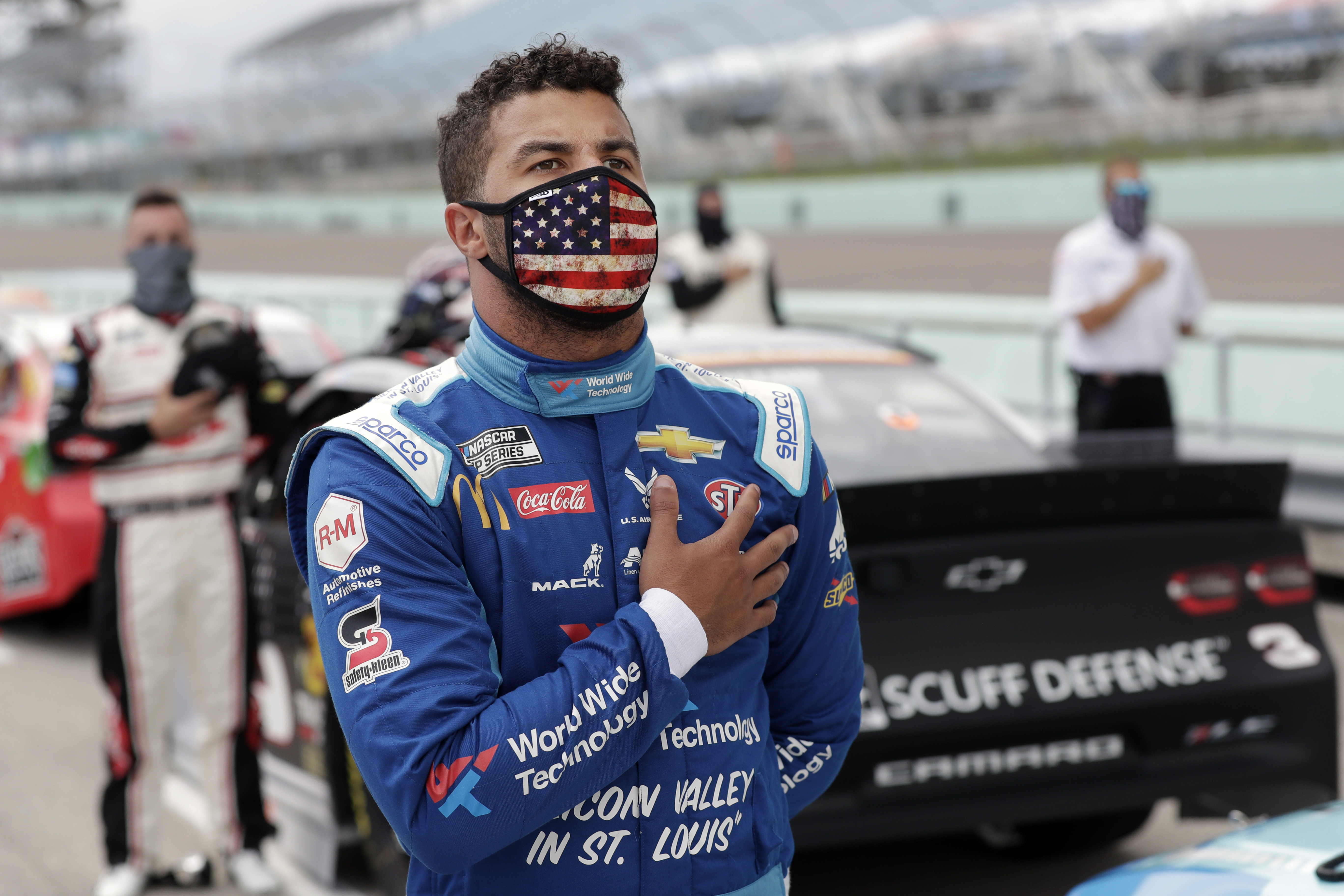 Bubba Wallace stands for the national anthem before a NASCAR Cup Series auto race on June 14, 2020, in Homestead, Fla.