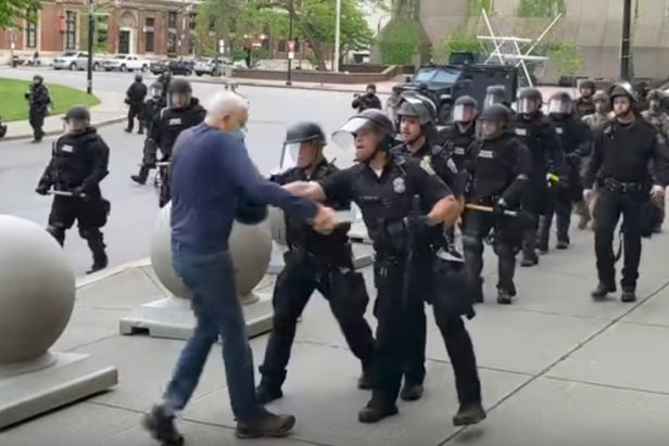 A Buffalo police officer appears to shove a man who walked up to police on June 4, 2020, in Buffalo, N.Y.