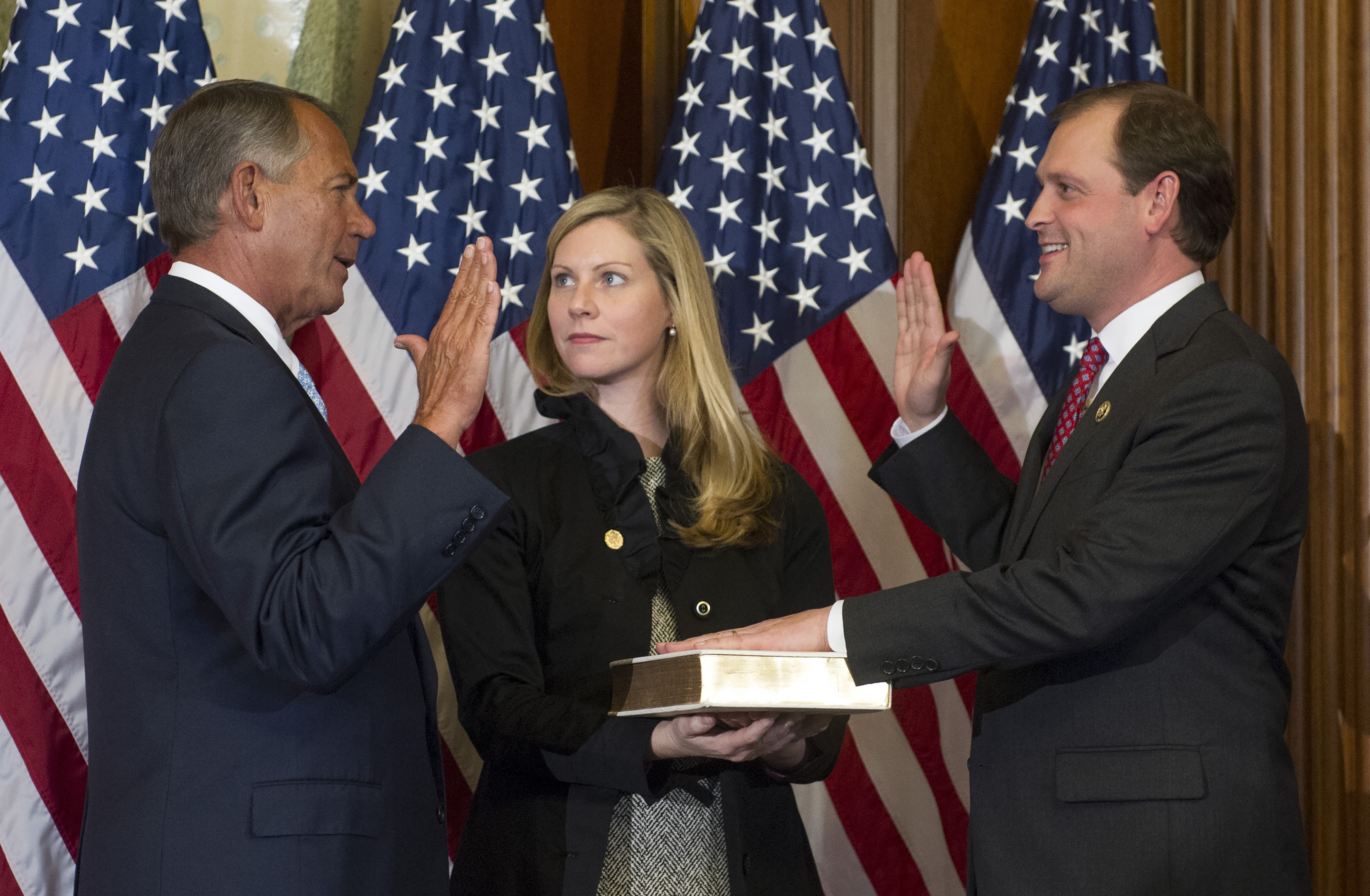 In this Jan. 6, 2015, file photo, then-House Speaker John Boehner of Ohio, left, administers a ceremonial re-enactment of the House oath-of-office to Rep. Andy Barr, R-Ky., accompanied by his wife Eleanor Carol Leavell on Capitol Hill