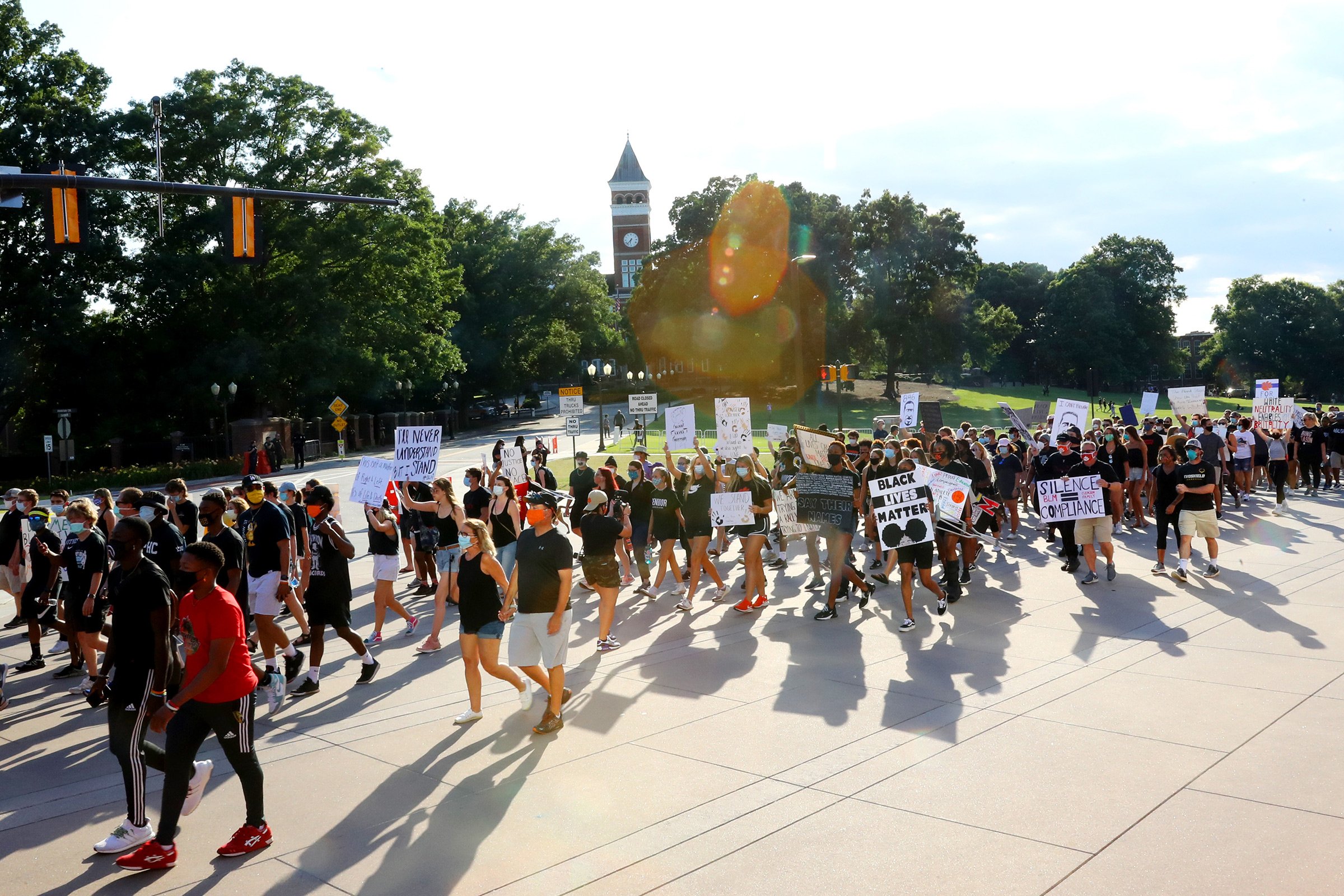 Clemson University football players lead a  March for Change  protest past Tillman Hall on June 13 in Clemson, South Carolina. The Clemson University Board of Trustees voted to strip  Calhoun  from their Honors College name and rename Tillman Hall.