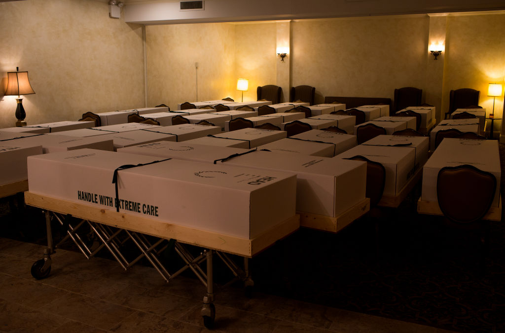 A funeral home in the epicenter of the COVID-19 pandemic deals with an excess of recent deaths because of the virus by storing bodies in the chapel and loading them up into a truck to ship to crematoriums and cemeteries on May 11, 2020 in the Elmhurst neighborhood of Queens, New York.