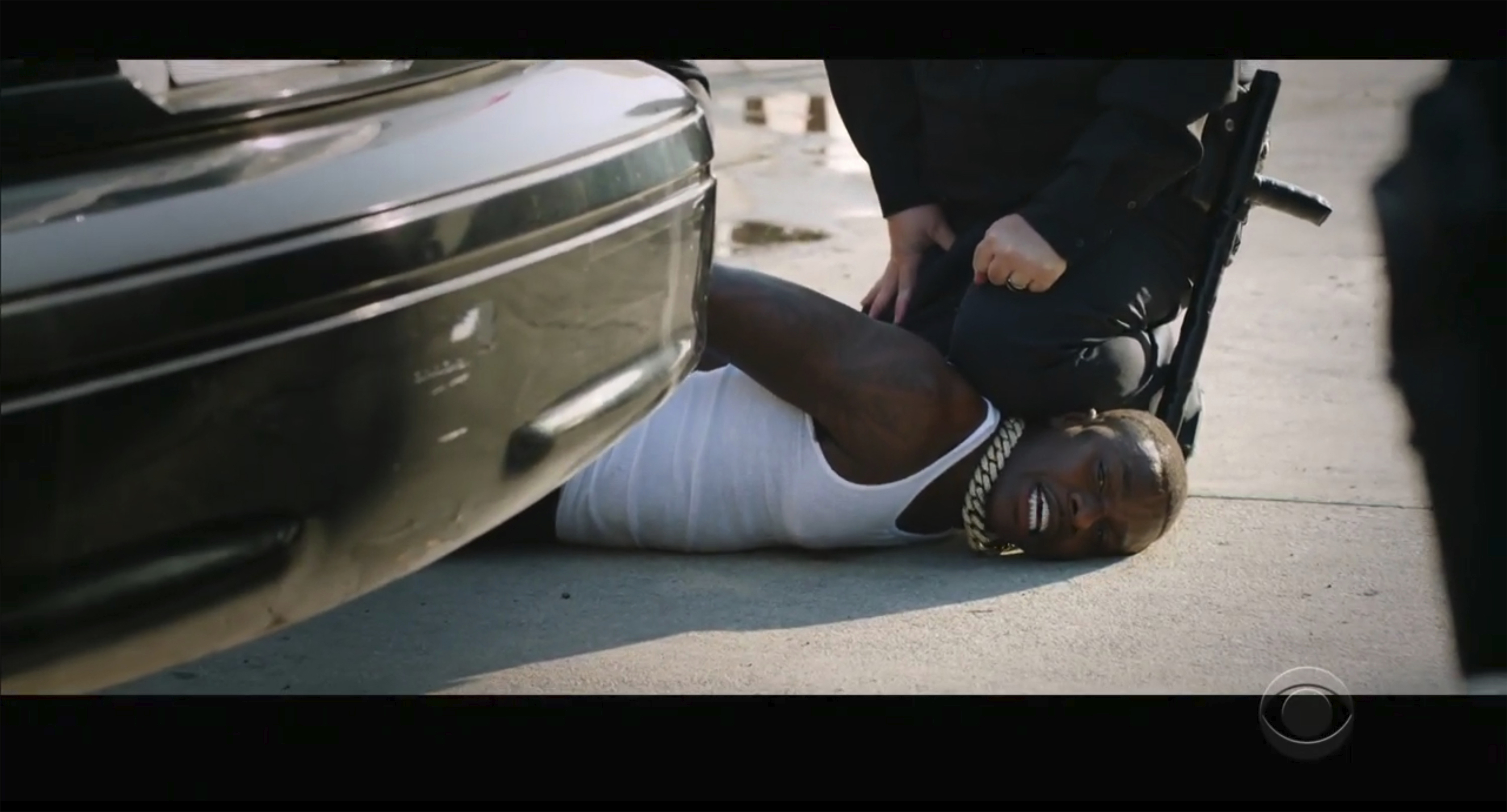 In this video grab issued Sunday, June 28, 2020, by BET, rapper DaBaby performs  Rockstar  as an actor playing a police officer presses his knee on DaBaby's neck, replicating the last few moments of George Floyd's life, during the BET Awards.