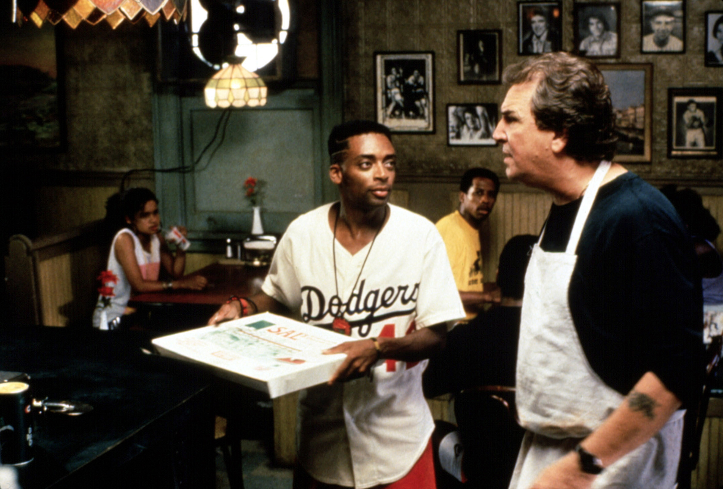 Spike Lee (center) and Danny Aiello (right) in Do the Right Thing, 1989