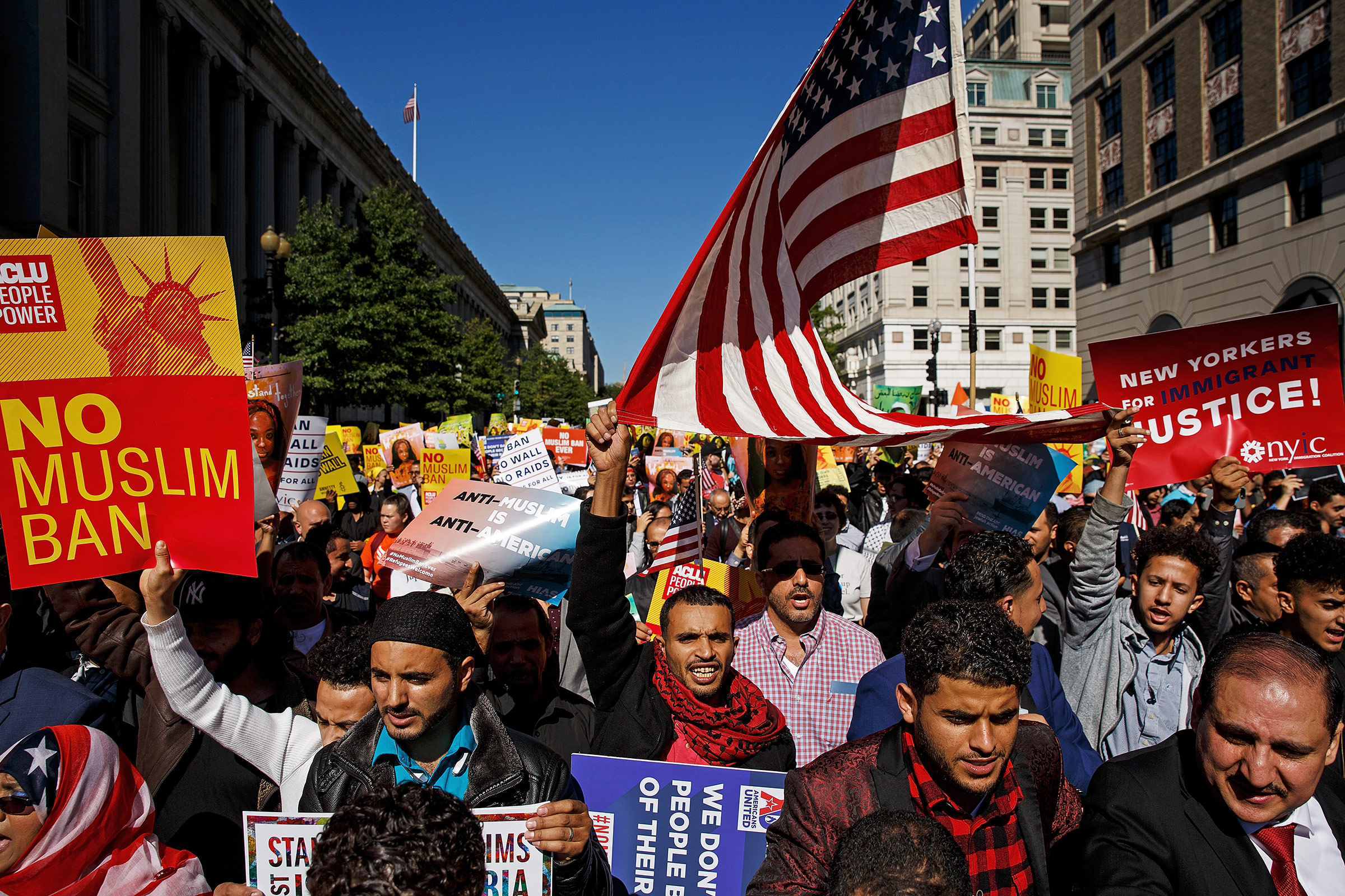Protesters in Washington, D.C., march against Trump's attempts to restrict travel from predominantly Muslim countries in October 2017