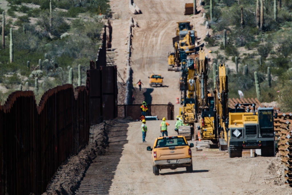 Contractors inspect a work site for the new U.S.-Mexico border wall in Lukeville, Arizona, on Feb. 26, 2020.