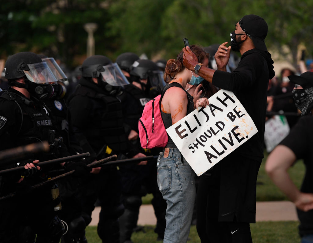 Elijah McClain protesters close to the Aurora place line at the Aurora Municipal Center June 27, 2020.