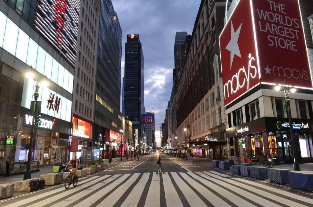 People cross an empty 34th Street in New York City's Herald Square on May 30, 2020.