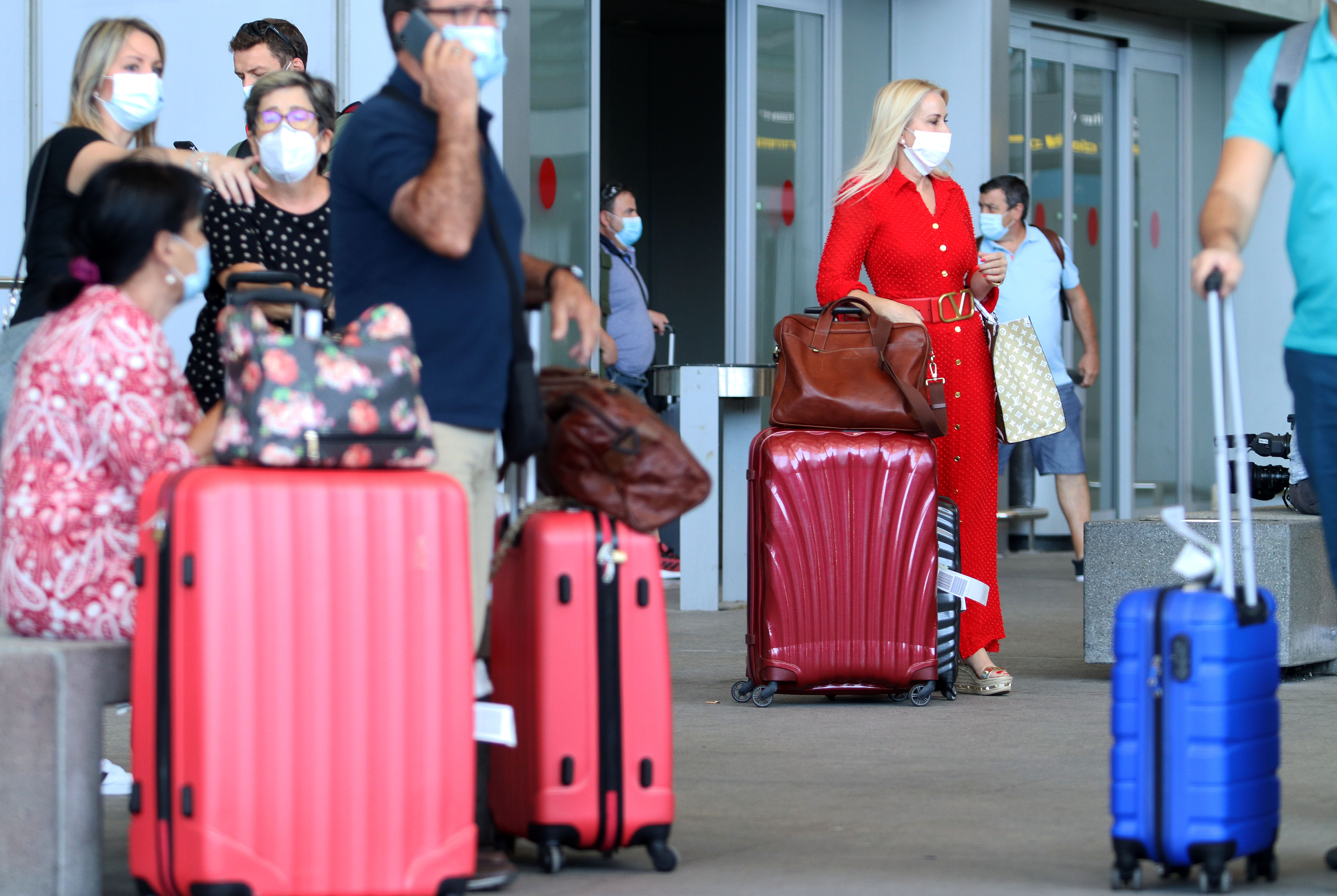 Tourists arrive at Pablo Ruiz Picasso Airport on June 22, 2020 in Malaga, Spain.