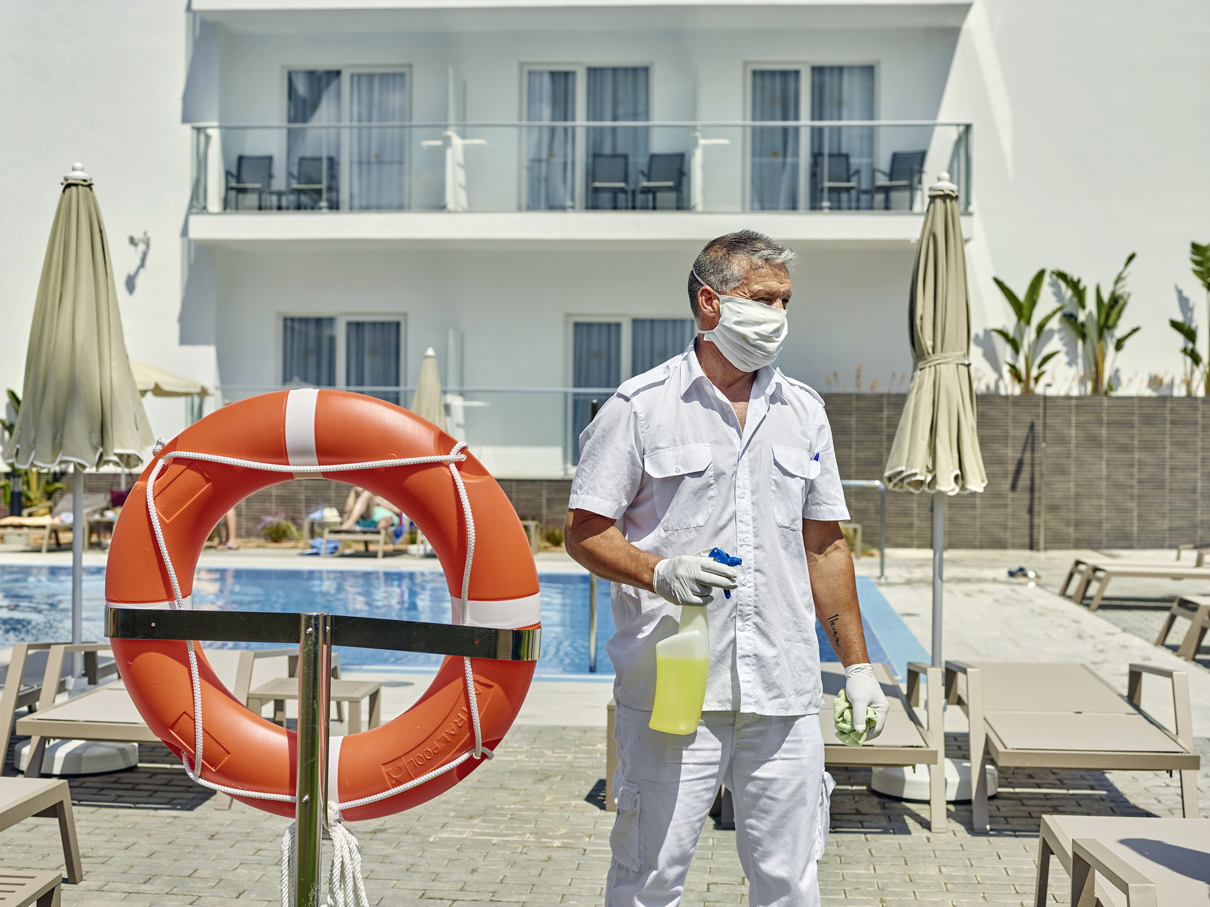 Disinfecting the pool area at the newly reopened Riu Concordia Hotel in Mallorca's Platja de Palma.