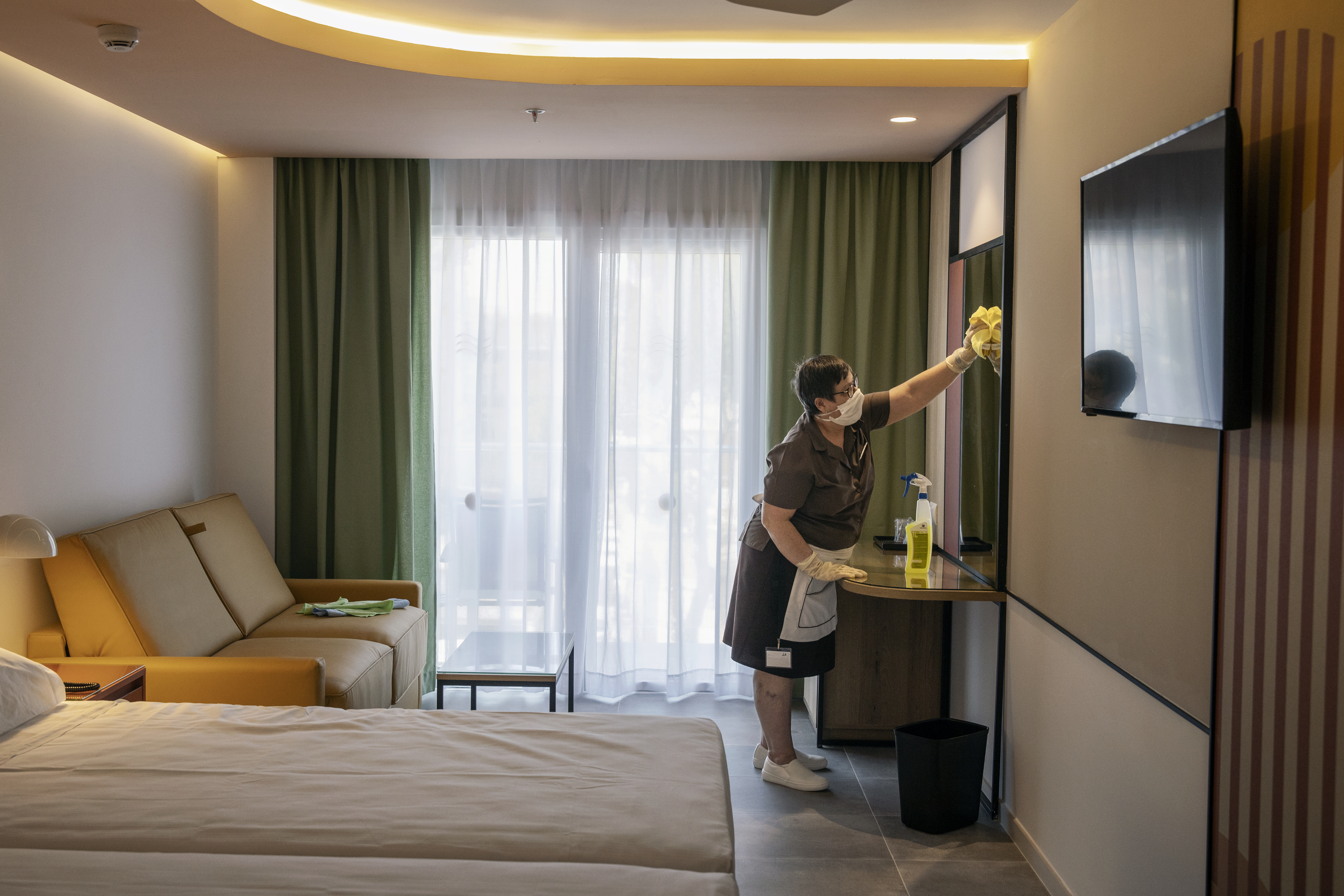 Playa de Palma, Mallorca, a member of the Riu Concordia Hotel staff at work cleaning and disinfecting a room on June 16, 2020.