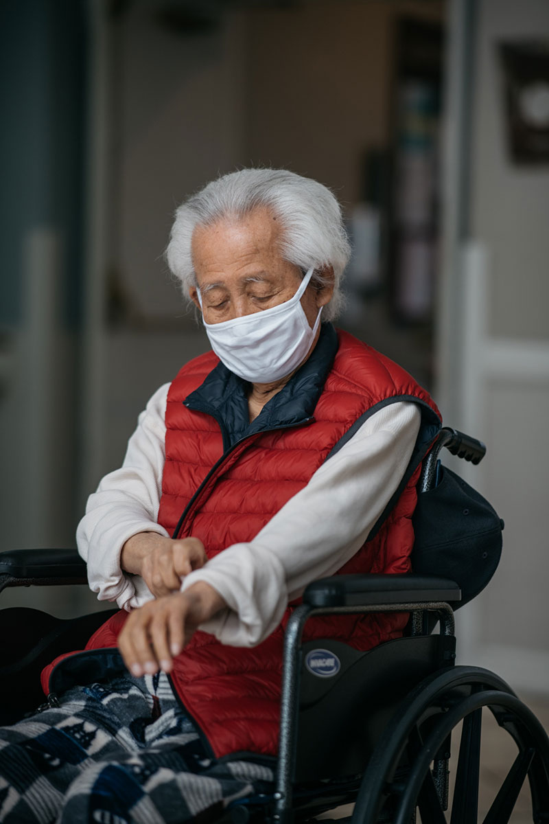 Noh Park, 92, prepares for his daughter's Father's Day visit at the Alexandria Care Center in Los Angeles.