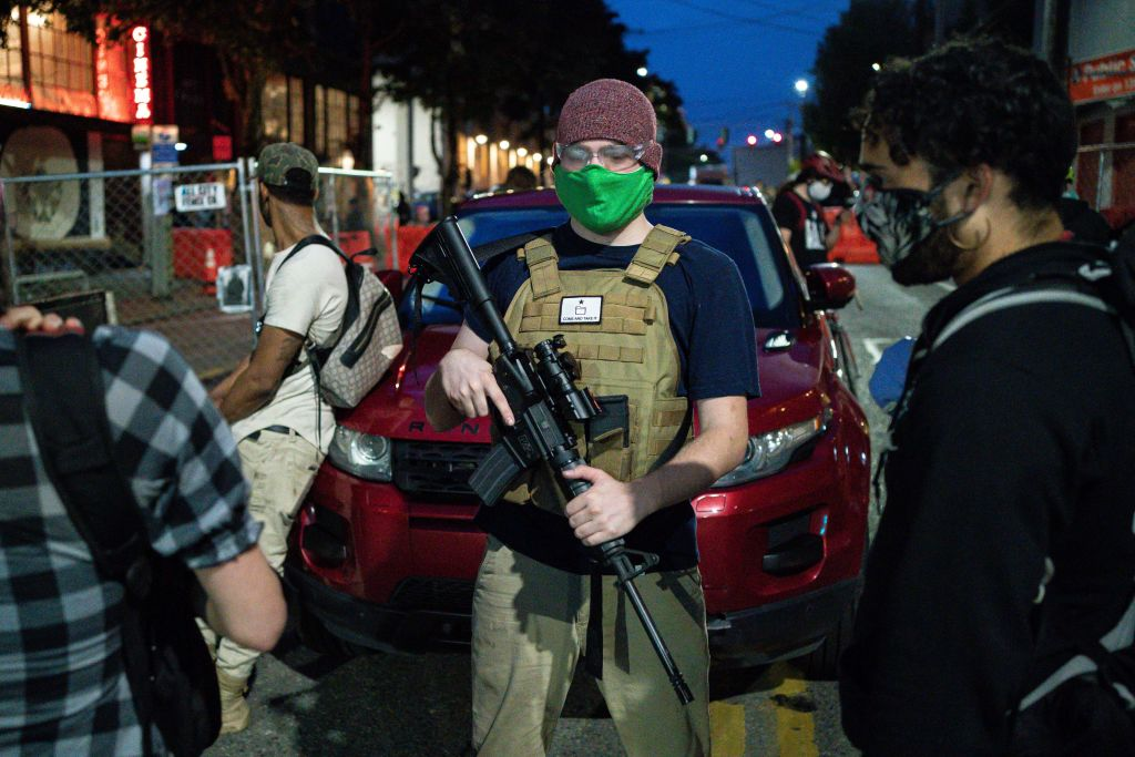 A volunteer works security at an entrance to the so-called  Capitol Hill Autonomous Zone  on June 10, 2020 in Seattle, Washington. Fox News' website featured at least two photos on Friday that digitally imposed this man on images of other protests.