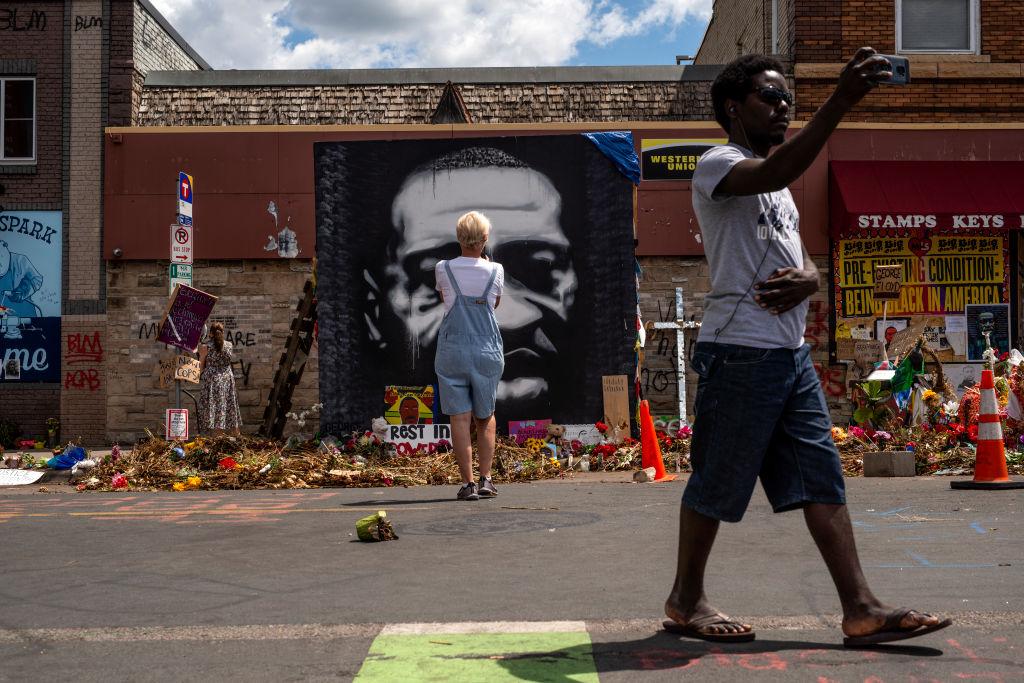 People visit a memorial site for George Floyd on June 24, 2020 in Minneapolis, Minnesota.