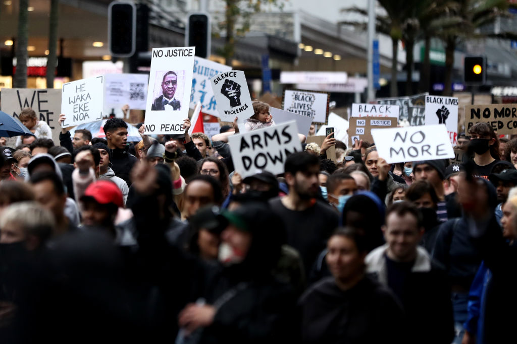 Protestors march down Queen Street on June 01, 2020 in Auckland, New Zealand. The rally was organised in solidarity with protests across the United States following the killing of George Floyd, an unarmed black man, in police custody in Minneapolis, Minnesota.