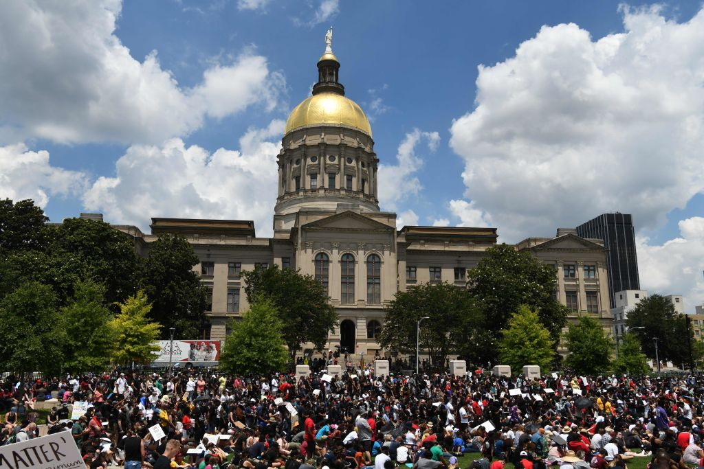 Protesters gather outside the Georgia State Capitol during a rally to mark Juneteenth on June 19, 2020, in Atlanta, Georgia.