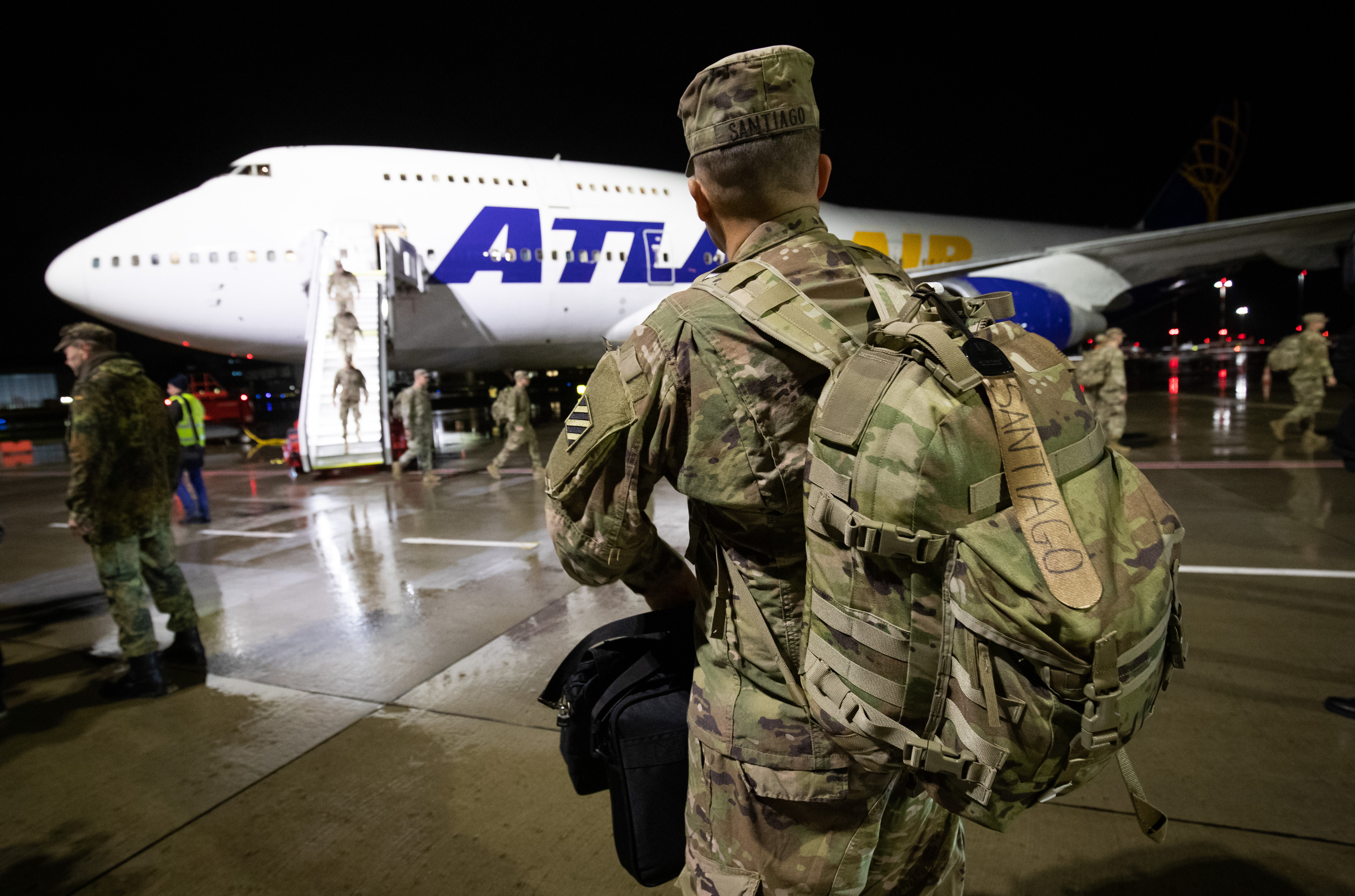 Soldiers of the 2nd Brigade of the 3rd Infantry Division from Fort Steward in the U.S. State of Georgia arrive at the airport as part of the ongoing major exercise  Defender Europe 20  and walk across the apron to the waiting buses in Hamburg on Feb. 21, 2020.