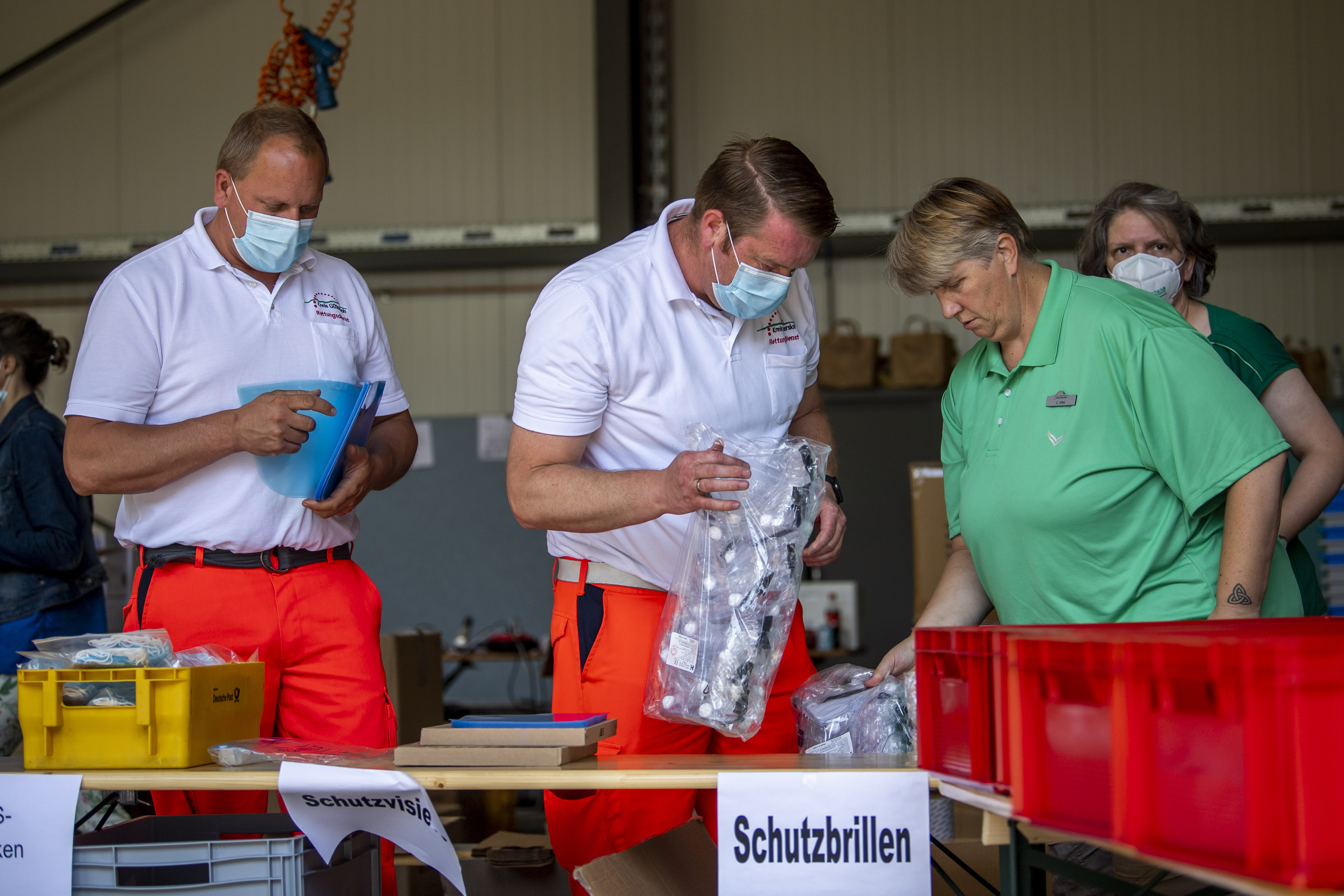 Mobile teams testing people on the coronavirus collect their equipment at a fire station in Rheda-Wiedenbrueck, Germany, June 23, 2020.