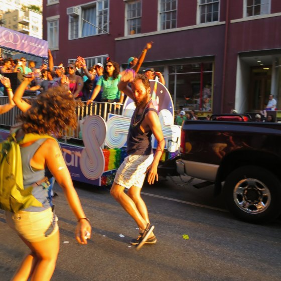 Ginger guy dancing on 8th Street, late afternoon PRIDE