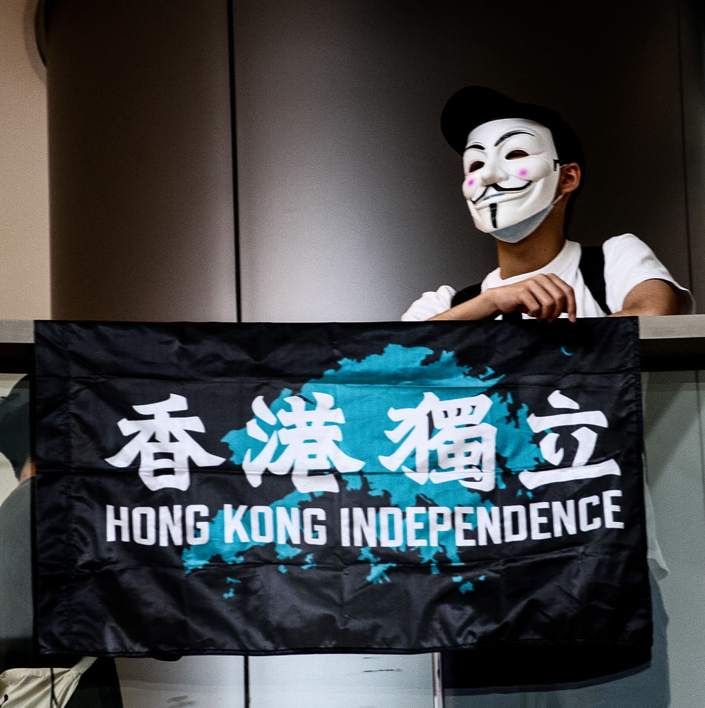 A protester holding up Hong Kong Independence flag, Lunch with You event, IFC Mall, Central, Hong Kong, May 29th, 2020.