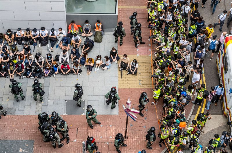 Police circle detainees near the city's legislature on May 27, as the debate over the national-security bill was set to resume