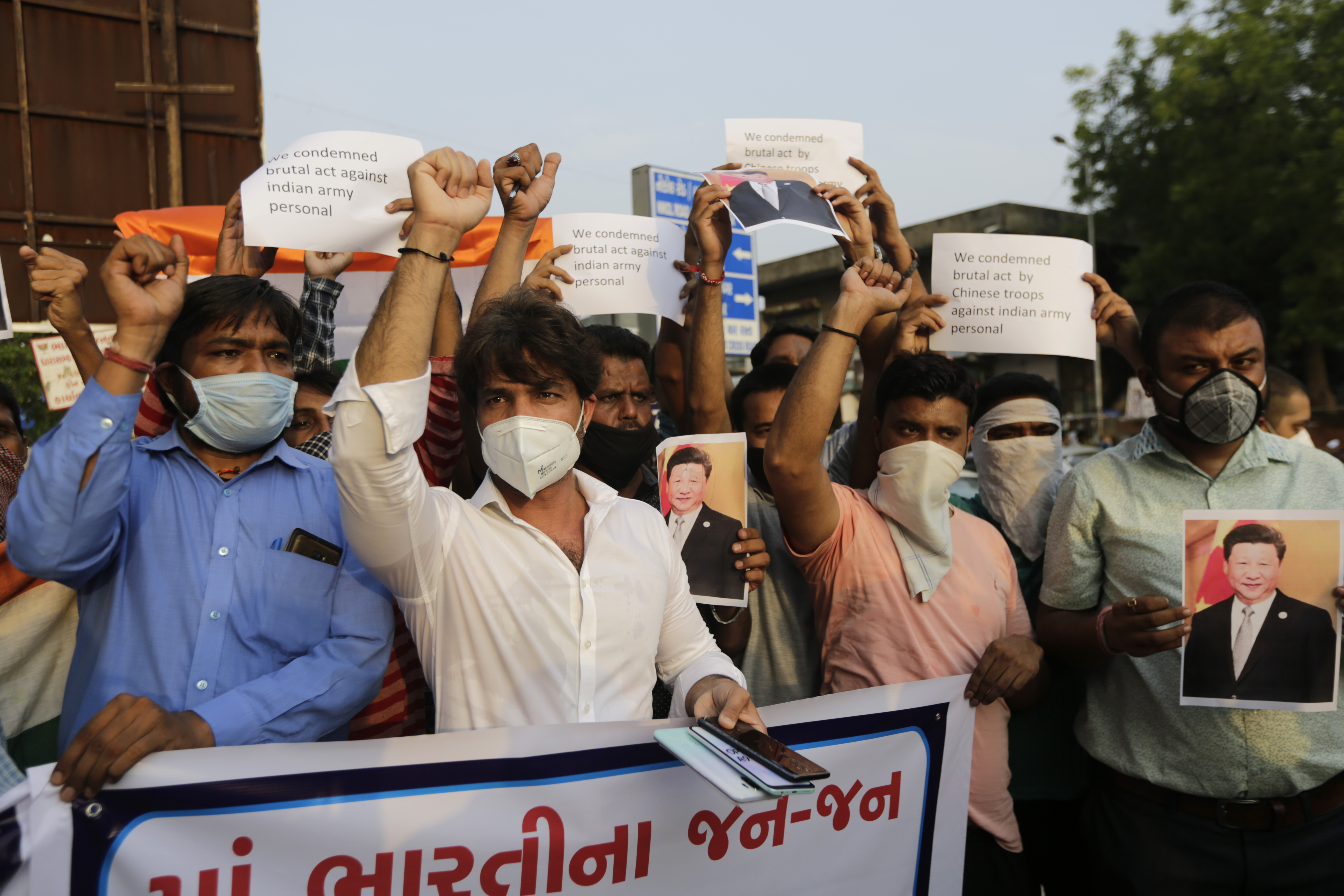 Indians shout slogans against China during a protest in Ahmedabad, India, June 16, 2020.