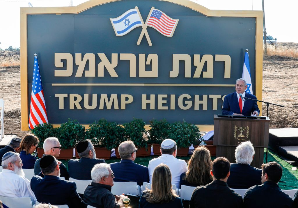Israeli Prime Minister Benjamin Netanyahu gives a speech before the newly-unveiled sign for the new settlement of  Ramat Trump , or  Trump Heights  in English, named after the incumbent U.S. President during an official ceremony in the Israeli-annexed Golan Heights on June 16, 2019.
