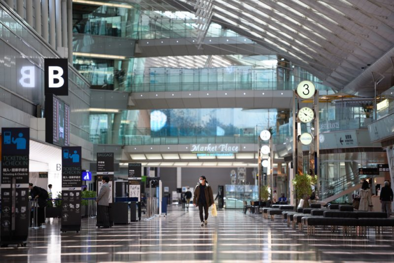 A man walks through the departures lobby at Haneda Airport in Tokyo, Japan, on April 23, 2020.