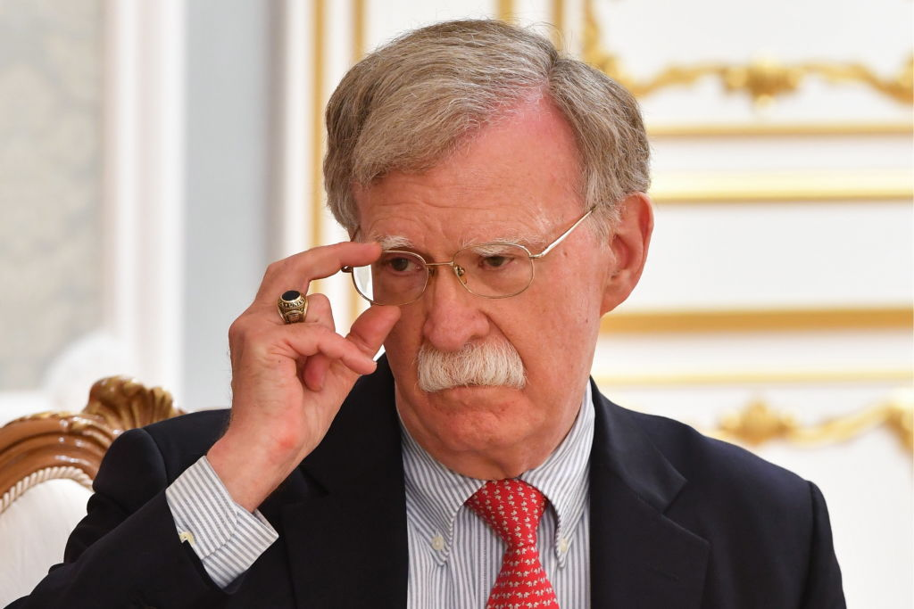 Then U.S. National Security Advisor John Bolton meets with Belarus' President Alexander Lukashenko in Minsk on Aug. 29, 2019.