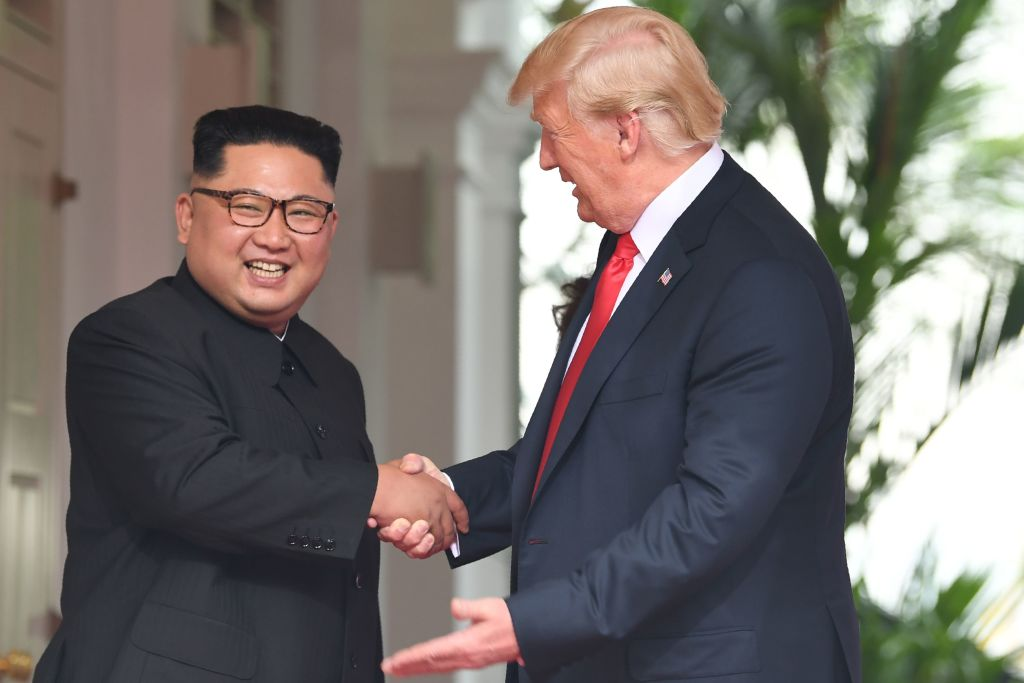 North Korea's leader Kim Jong Un shakes hands with President Donald Trump at the start of their historic U.S.-North Korea summit, on Sentosa island in Singapore on June 12, 2018.