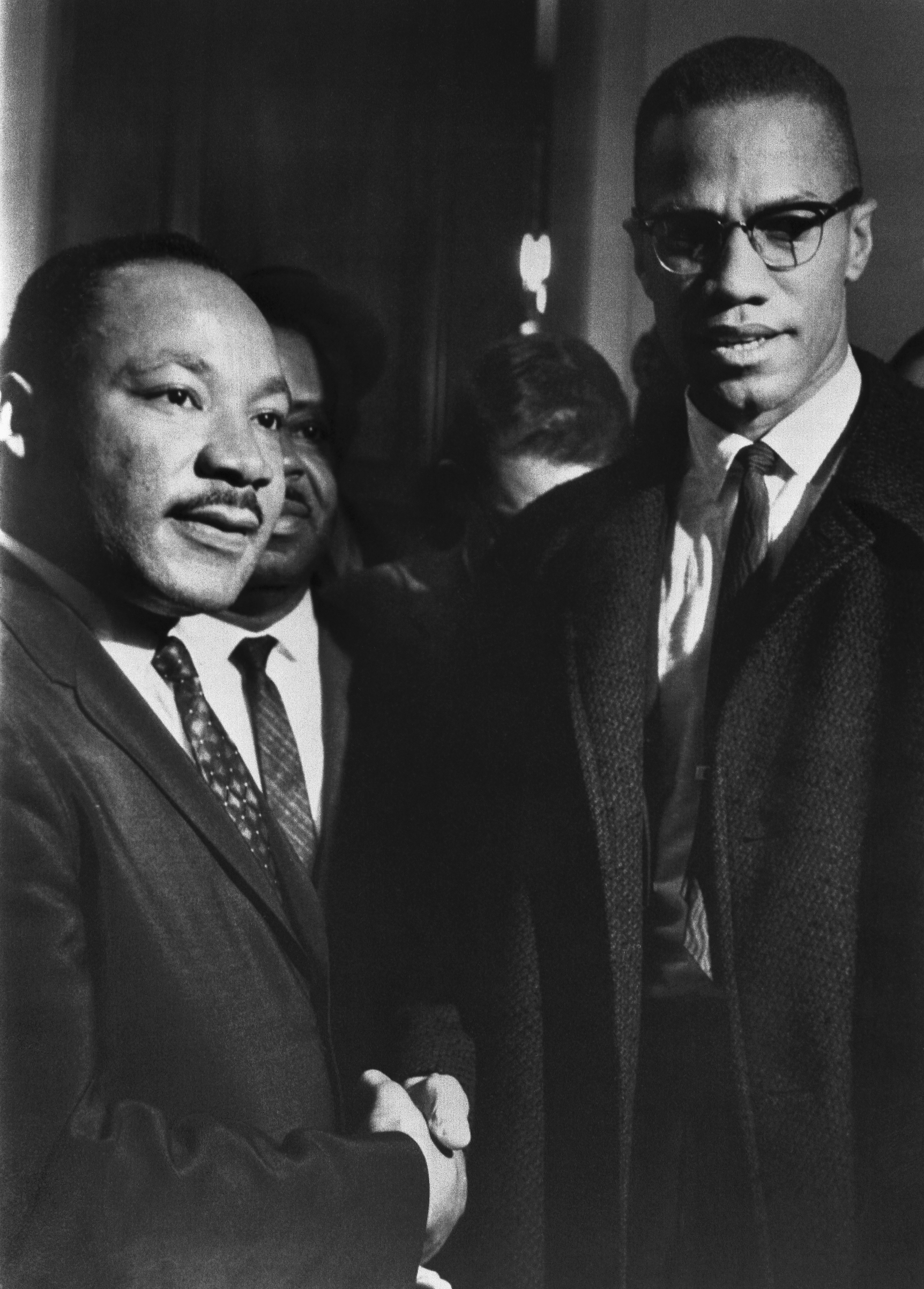 The brief, and only, meeting between Malcolm X and Martin Luther King, in the halls of the U.S. Capitol, observing a Senate filibuster on the Voting Rights Act in 1964.
