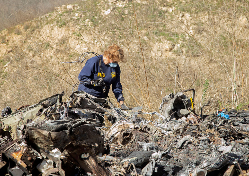 In this handout photo provided by the National Transportation Safety Board, an investigator works at the scene of the helicopter crash that killed former NBA star Kobe Bryant and his 13-year-old daughter Gianna on January 27, 2020 in Calabasas, California.