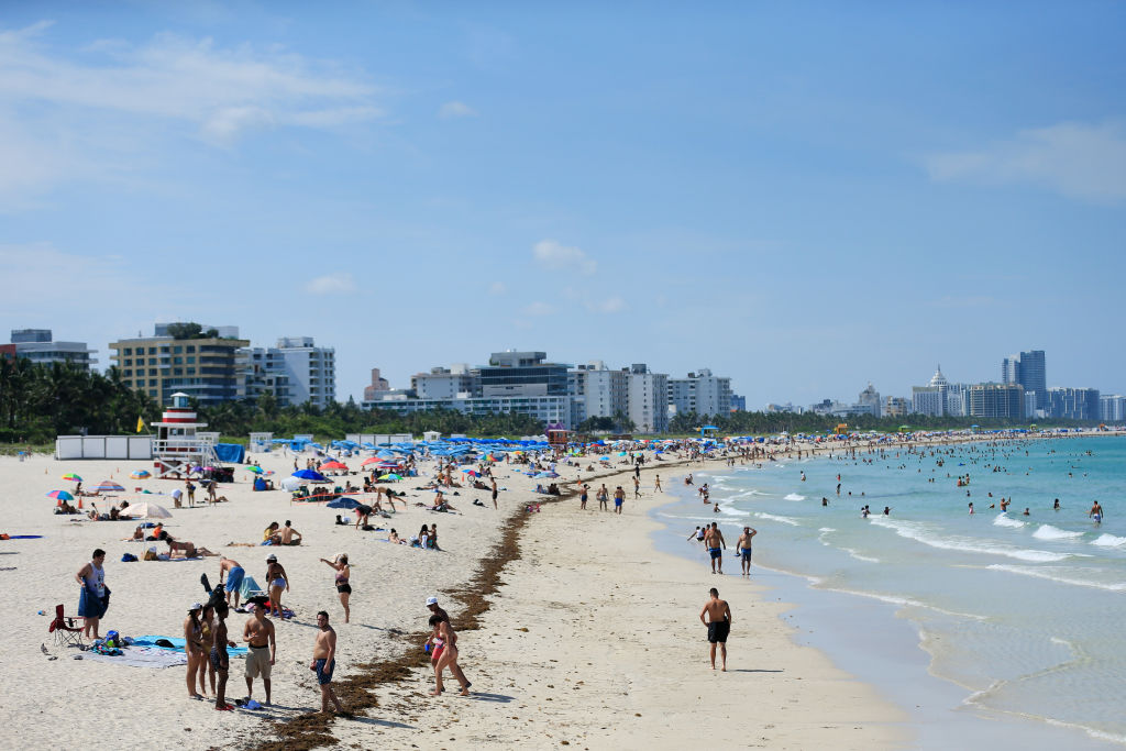 Beachgoers take advantage of the opening of South Beach on June 10, 2020 in Miami Beach, Florida.