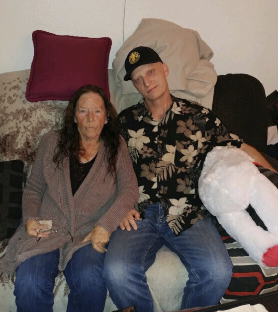 In this 2018, file photograph released by lawyer Mark Zaid, Michael White, right, is seen with his mother, Joanne White.