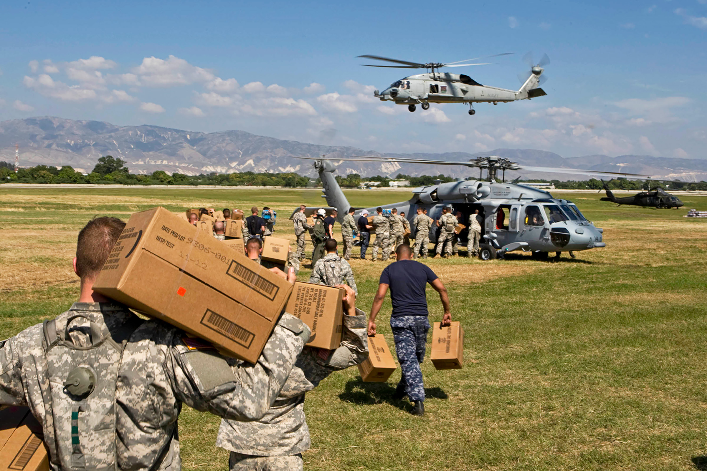 U.S. soldiers load aid onto a helicopter in January 2010 in Port-au-Prince, Haiti, after a devastating earthquake