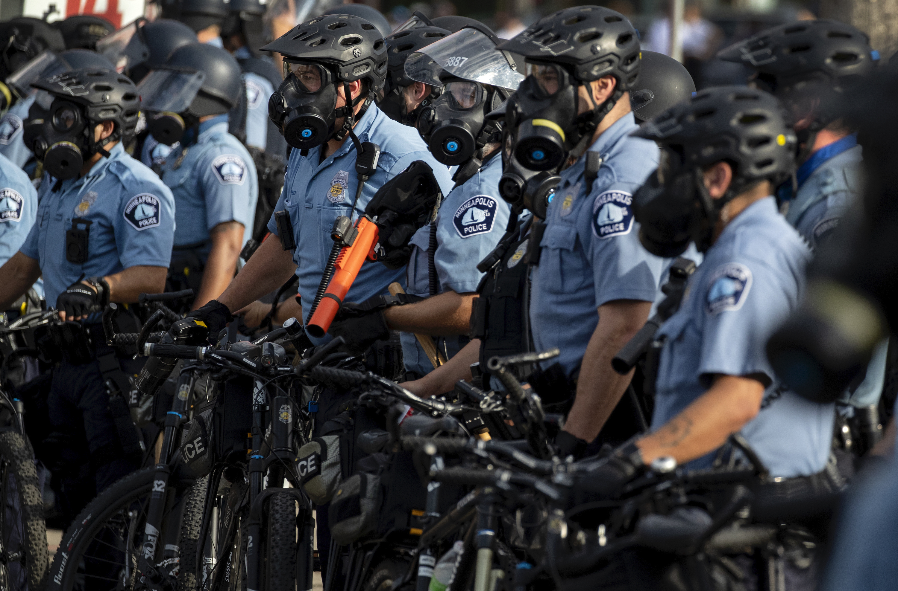 Minneapolis Police officers lined up as demonstrators protested the killing of George Floyd outside the Minneapolis Police Department's Third Precinct office in south Minneapolis on May 27, 2020.