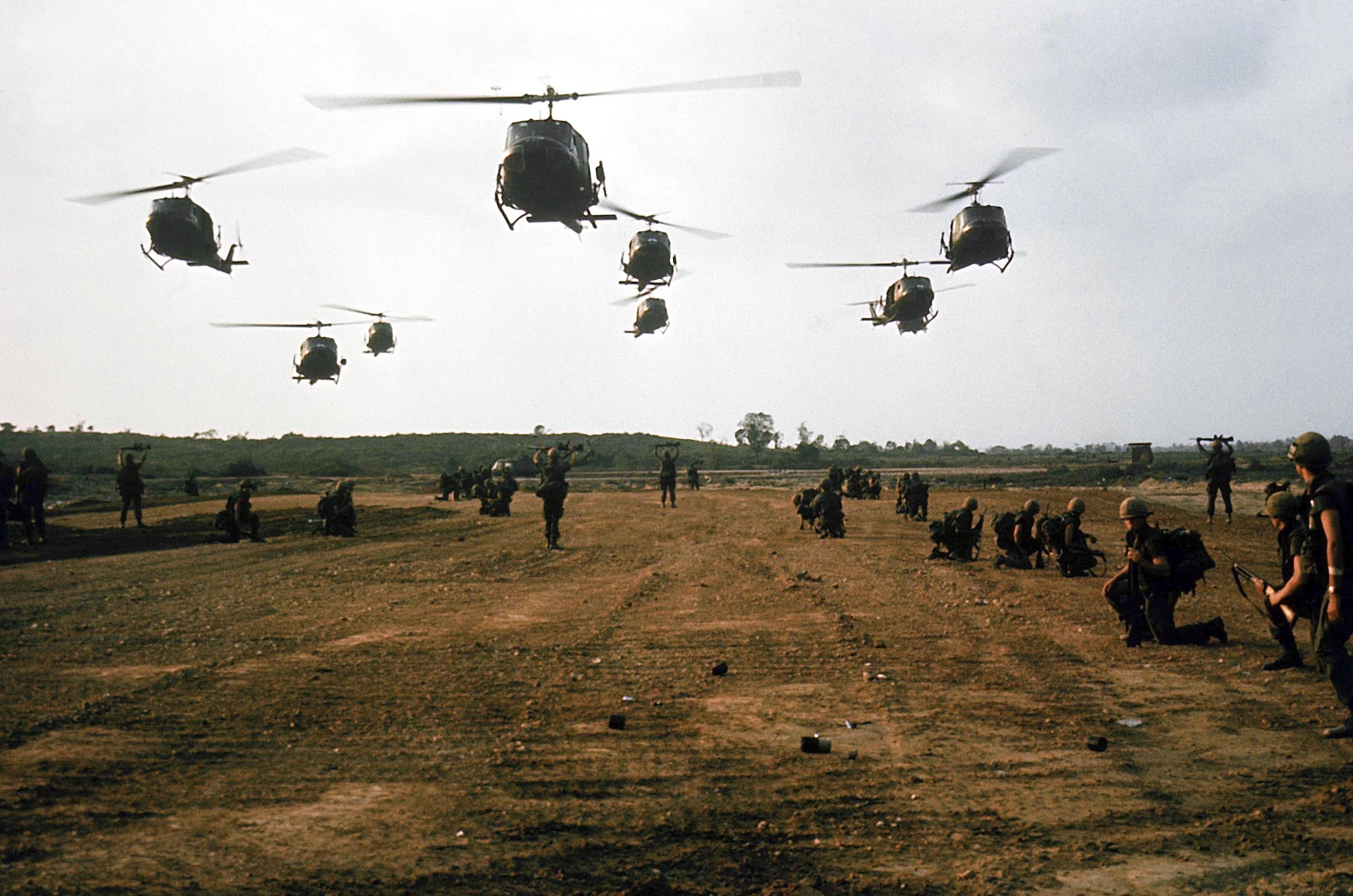 American military Bell UH-1D Iroquois ( Huey ) helicopters in flight during the My Lai massacre on March 16, 1968 in My Lai, South Vietnam.