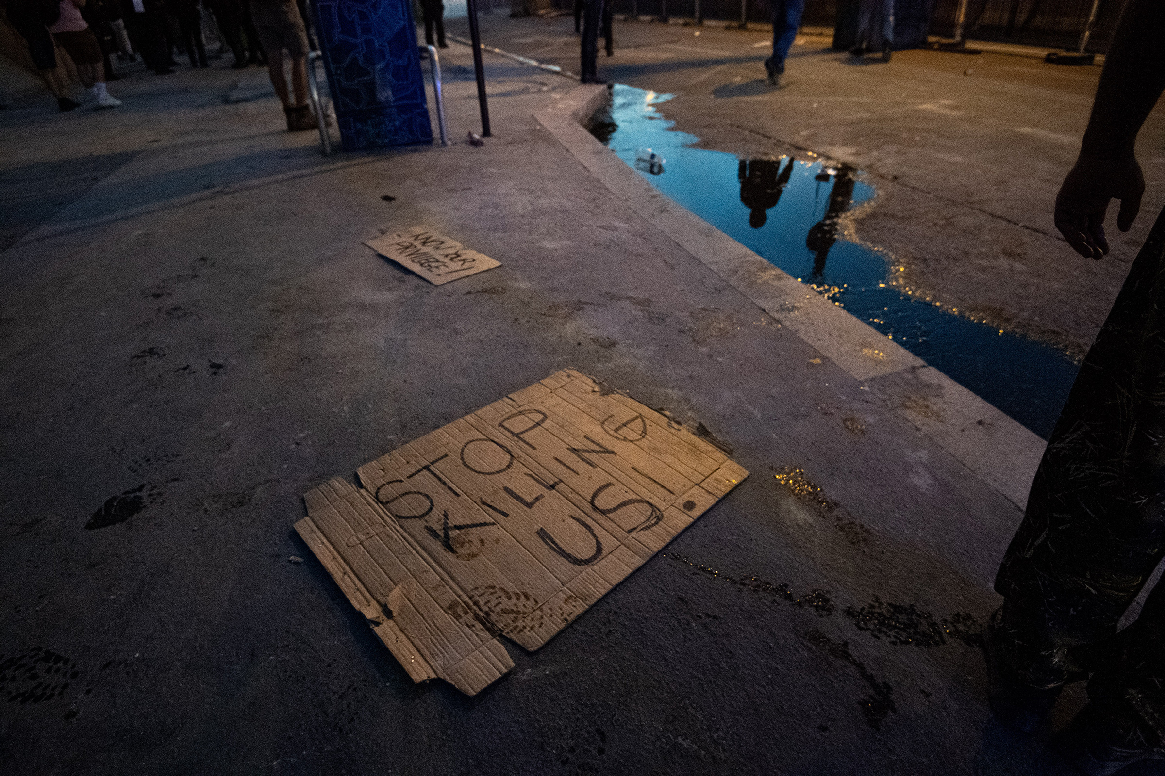 Signs are seen on the floor after clashes erupt following the intervention of security forces in a protest against police brutality at the Tribunal de Paris courthouse on June 2.