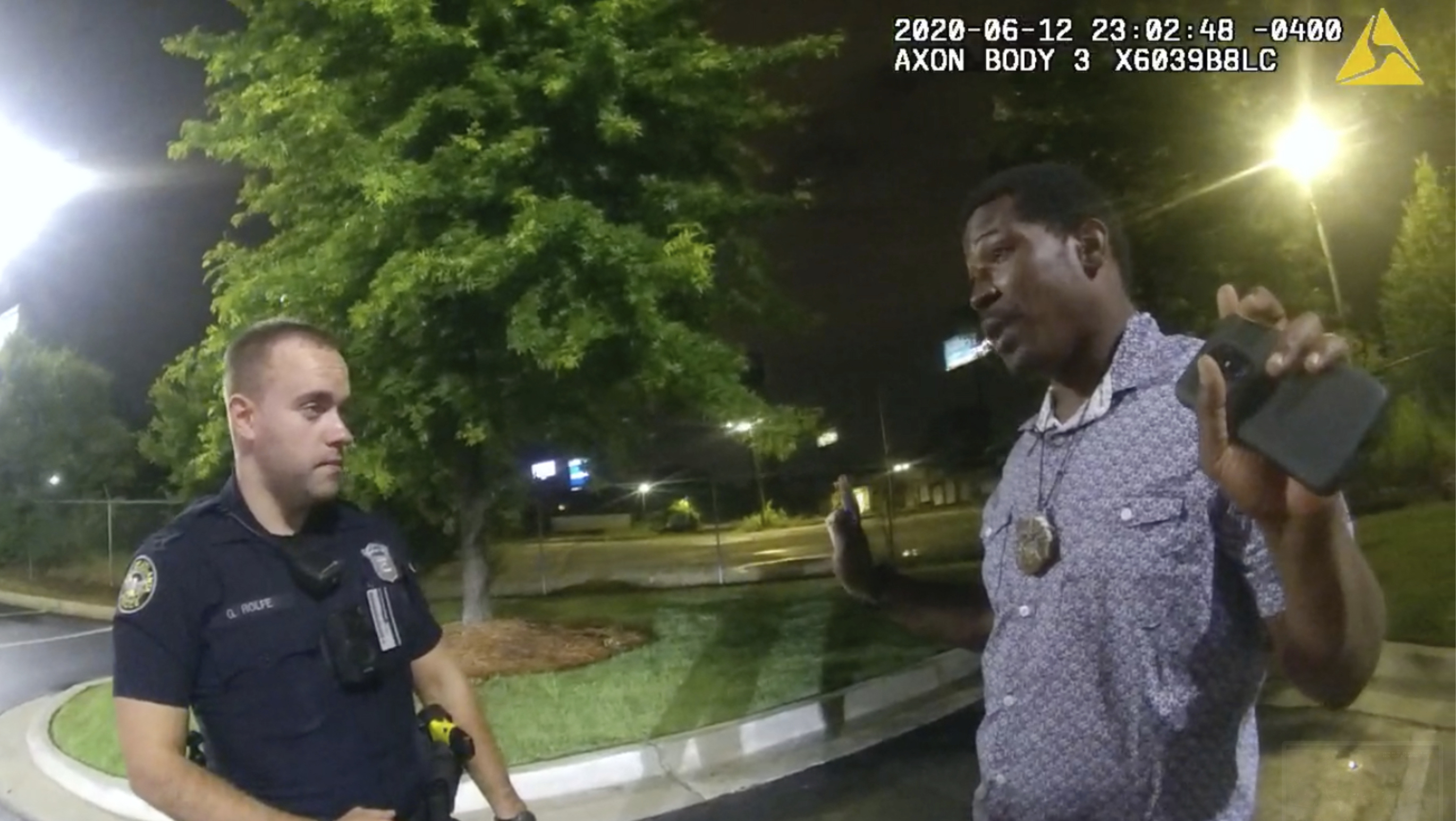 This screen grab taken from body camera video provided by the Atlanta Police Department shows Rayshard Brooks speaking with Officer Garrett Rolfe, left, in the parking lot of a Wendy's restaurant, June 12, 2020, in Atlanta.