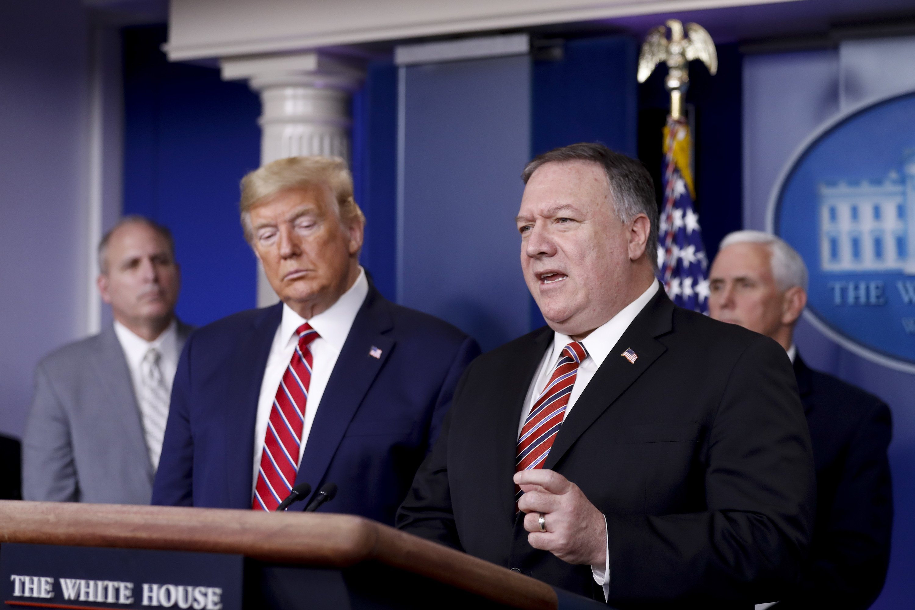 Mike Pompeo, U.S. secretary of state, speaks as U.S. President Donald Trump, second left, listens during a Coronavirus Task Force news conference in the briefing room of the White House in Washington, D.C., U.S., on March 20, 2020.