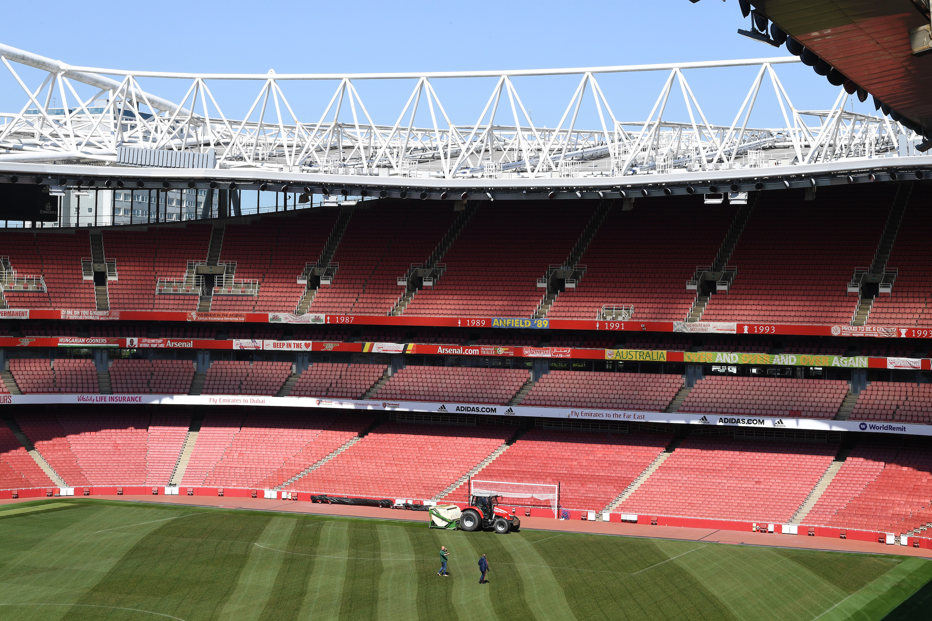 Ground staff work on the pitch at the Emirates Stadium on April 20, 2020 in London, England.