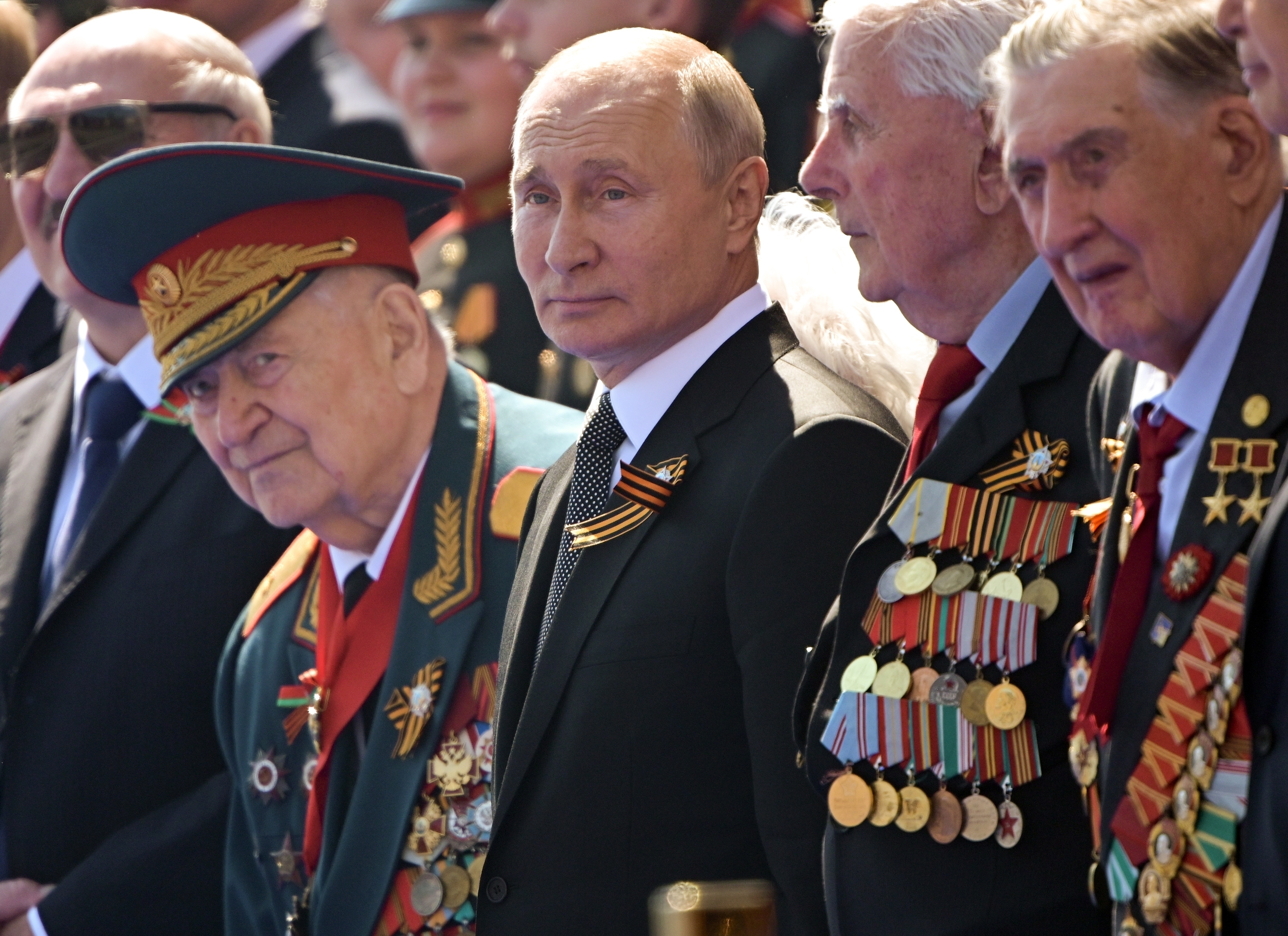 In this file photo taken on Wednesday, June 24, 2020, Russian President Vladimir Putin, center, watches the Victory Day military parade marking the 75th anniversary of the Nazi defeat in Moscow. Russian authorities seem to be pulling out all the stops to get people to vote on a series of constitutional amendments that would enable President Vladimir Putin to stay in office until 2036 by resetting the clock on his term limits.