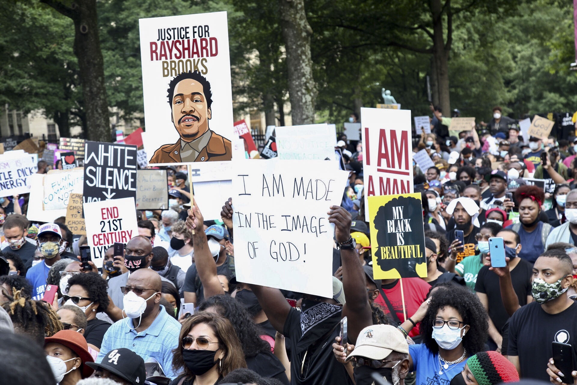 A crowd of demonstrators march to the Capitol June 15, 2020 in Atlanta.