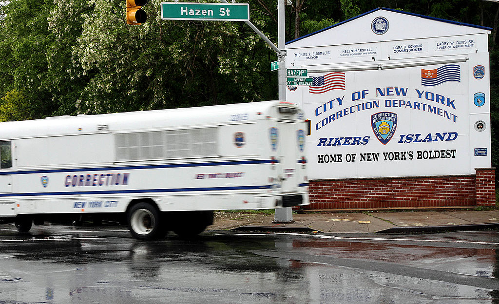 A New York City Corrections bus turns off of the Rikers Island entry road in New York, U.S., on Friday, May 20, 2011.