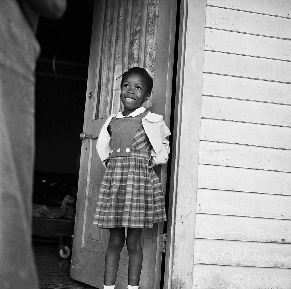 Ruby Nell Bridges at age 6, was the first African American child to attend William Franz Elementary School in New Orleans after Federal courts ordered the desegregation of public schools