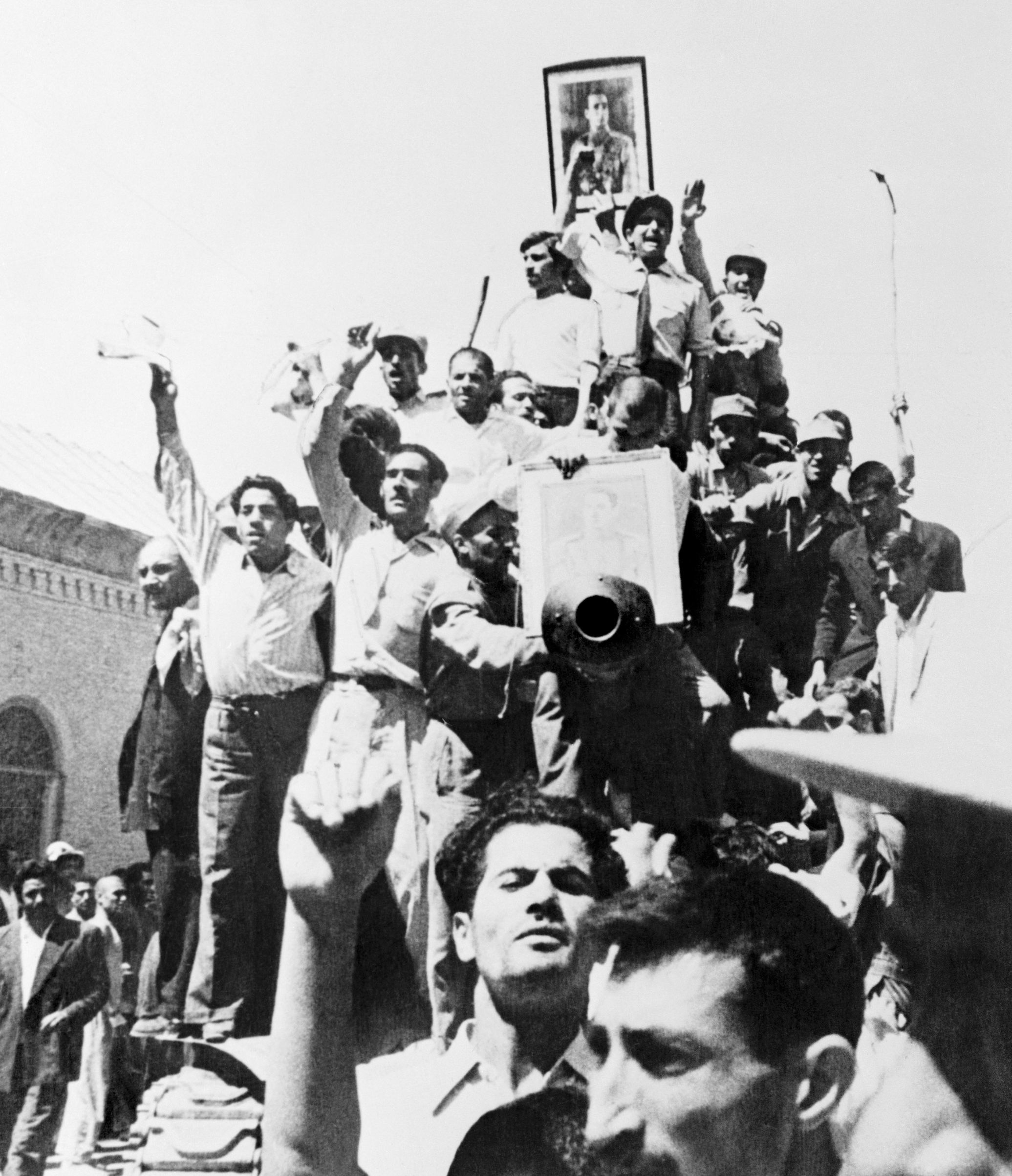 A portrait of the Shah is carried atop an Iranian Army tank patrolling the streets of Teheran after the coup that overthrew the regime of Premier Mohammed Mossadegh in 1953.